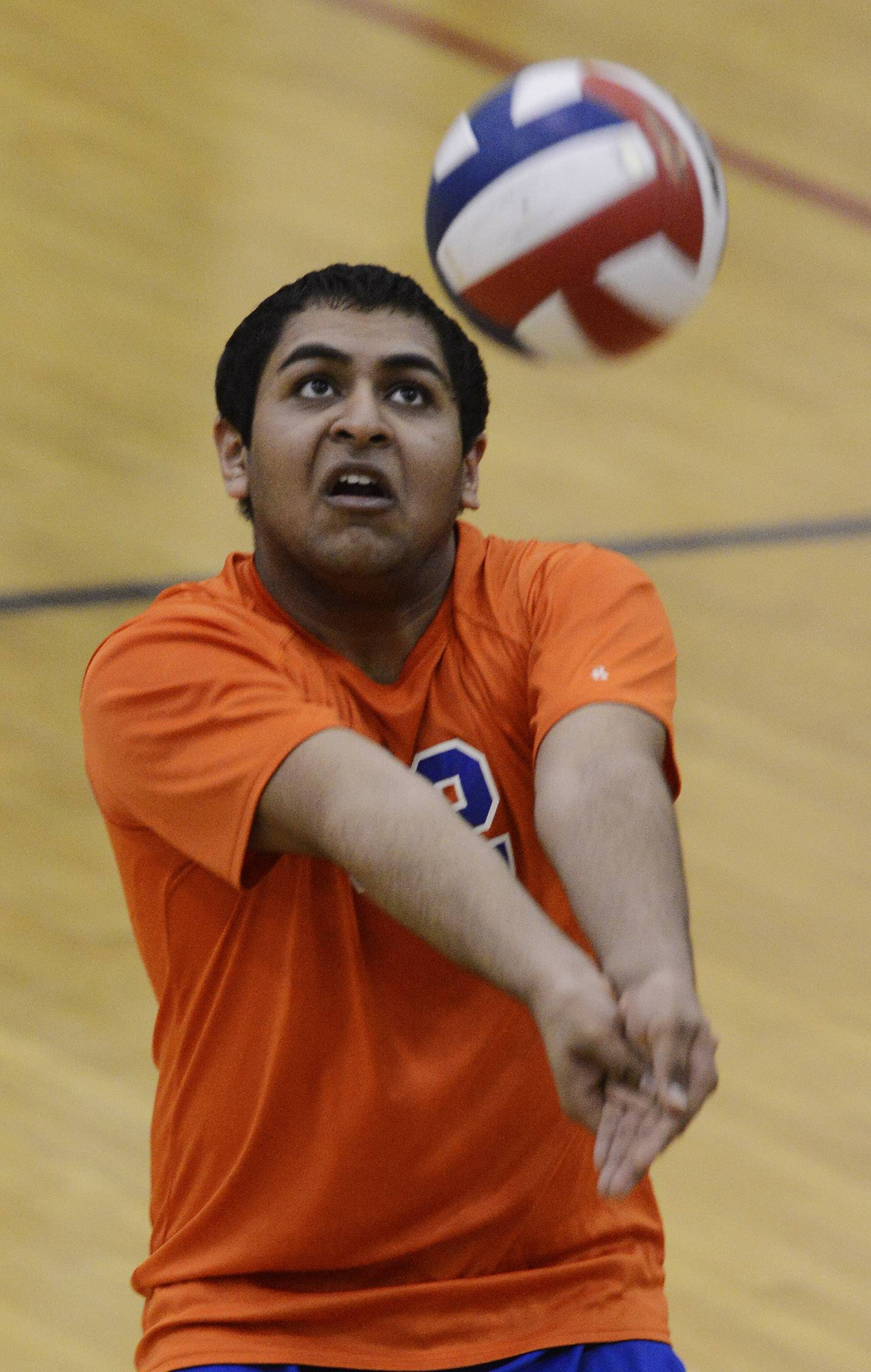 Hoffman Estates' Hardik Patel hustles for a dig during Tuesday's match against Conant.