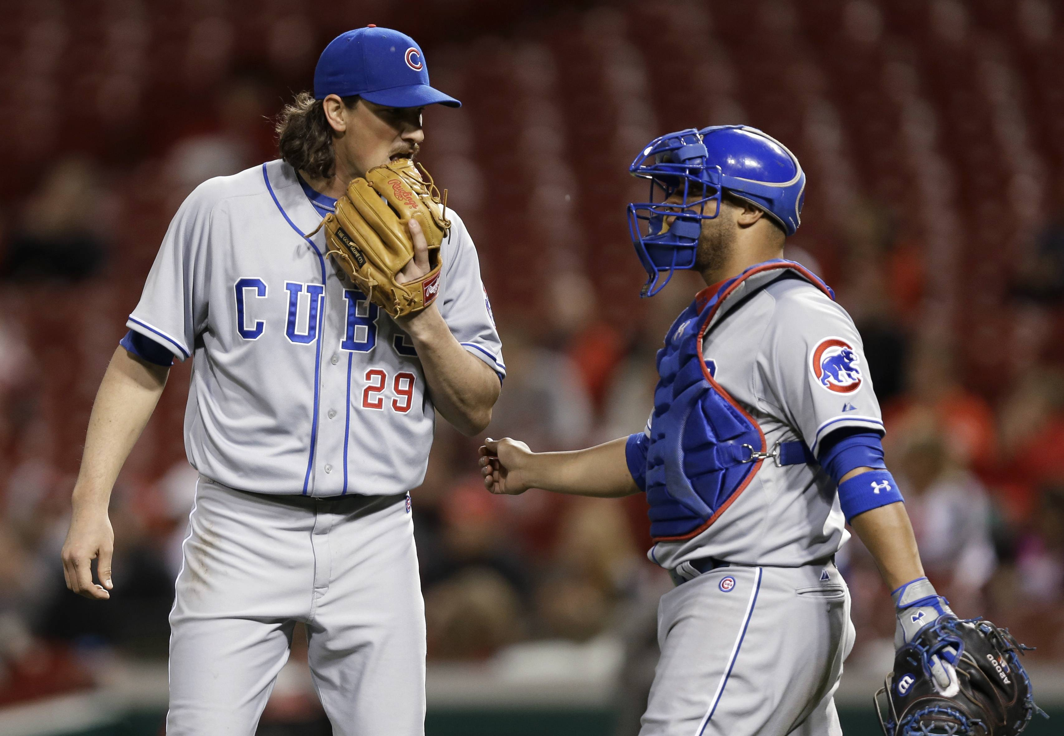 Chicago Cubs starting pitcher Jeff Samardzija (29) talks with catcher Welington Castillo in the sixth inning of a baseball game Tuesday against the Cincinnati Reds in Cincinnati.