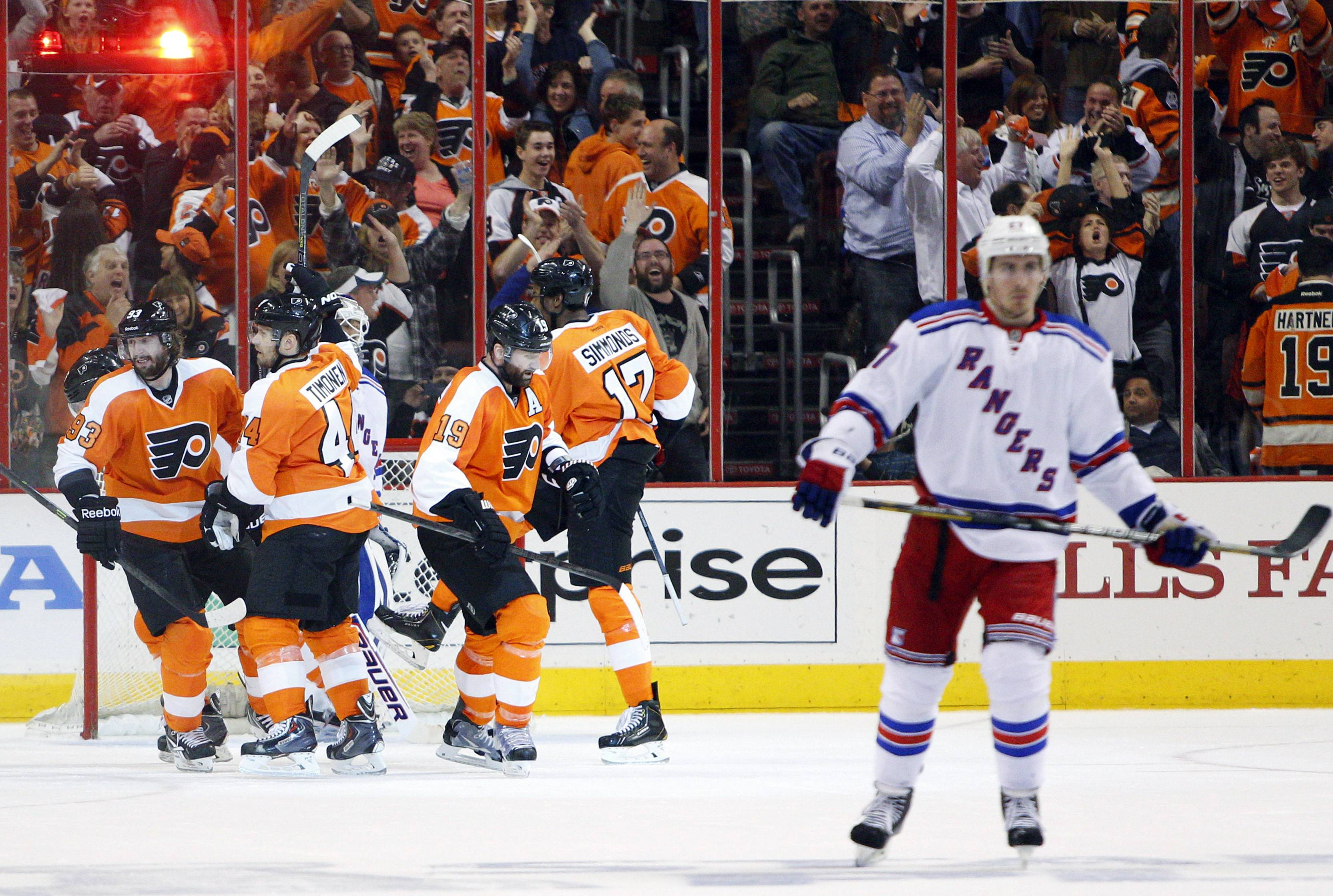 Philadelphia Flyers' Wayne Simmonds, second from right, celebrates his hat trick with teammates during the second period in Game 6 of an NHL hockey first-round playoff series Tuesday against the New York Rangers in Philadelphia.