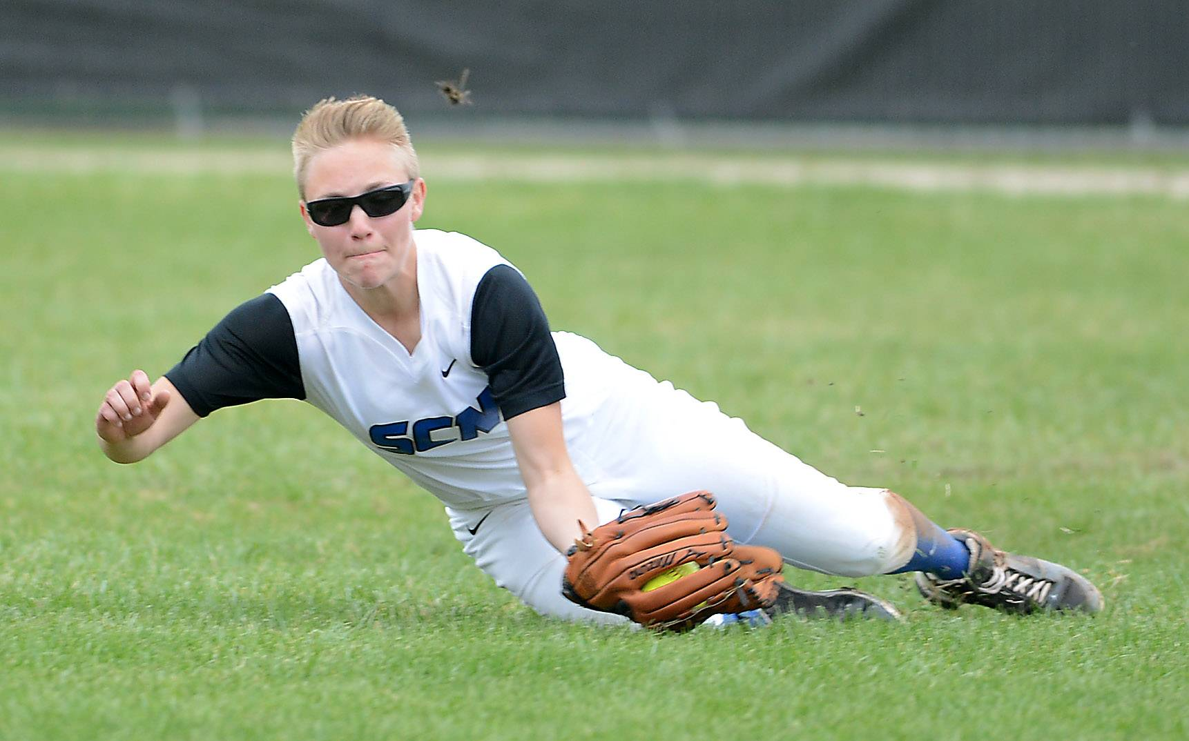 St. Charles North's Andrea Beal makes a sliding, diving catch during Tuesday's game in St. Charles.