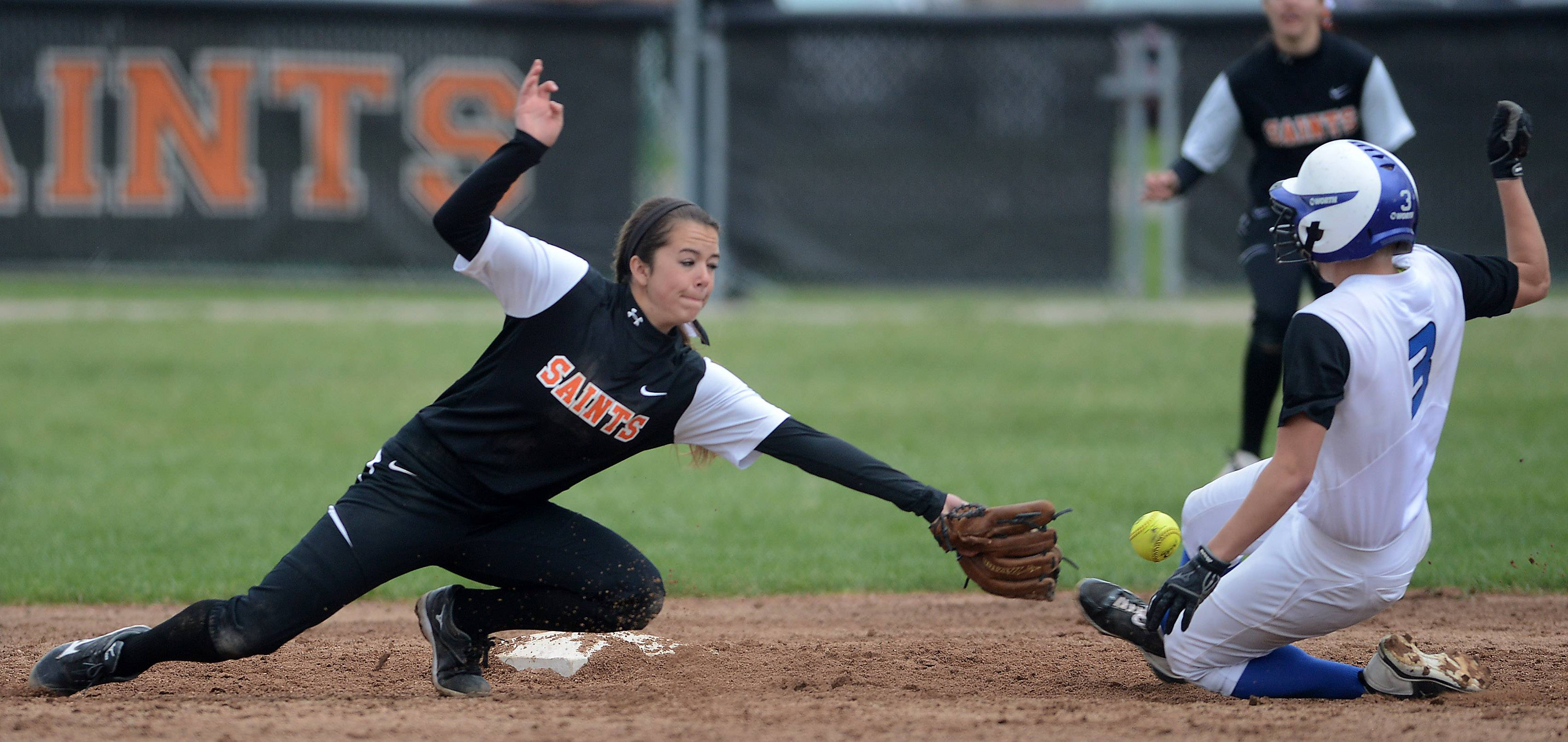 St. Charles North's Andrea Beal slides safely in to second as St. Charles East's Olivia Cheatham takes the late throw during Tuesday's game in St. Charles.