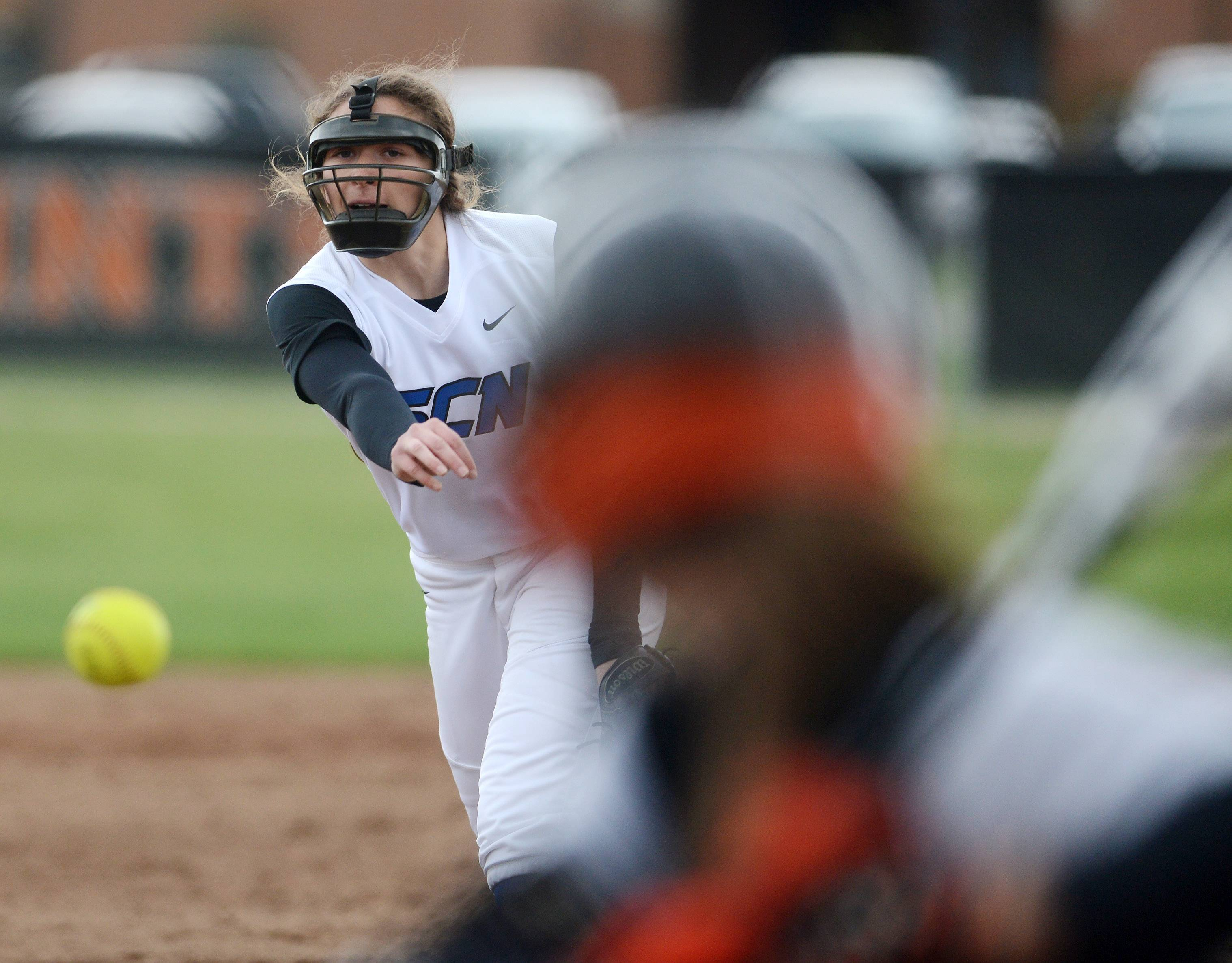 St. Charles North's Sabrina Rabin delivers a pitch to a St. Charles East batter during Tuesday's game in St. Charles.