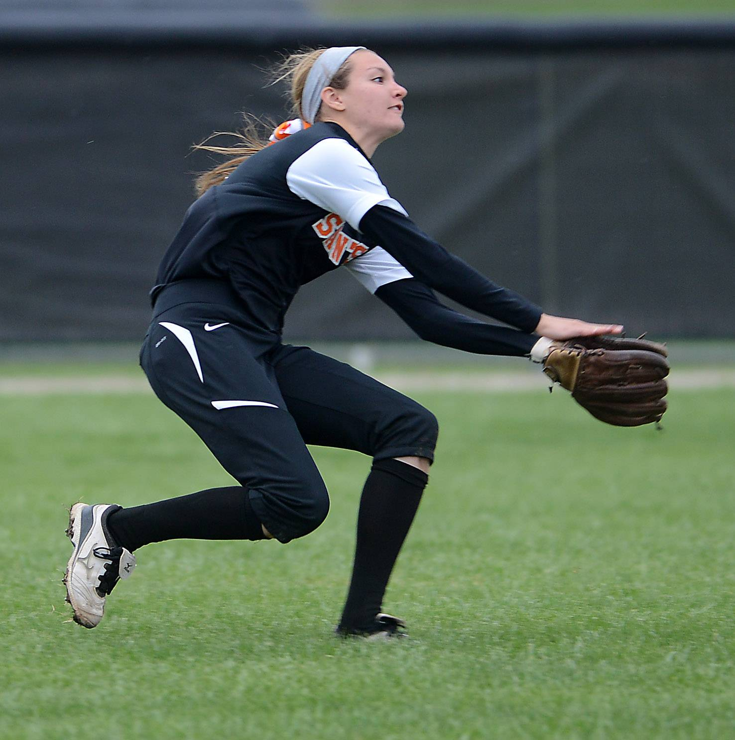 St. Charles East's Tess Hupe makes a running catch from center field during Tuesday's game in St. Charles.
