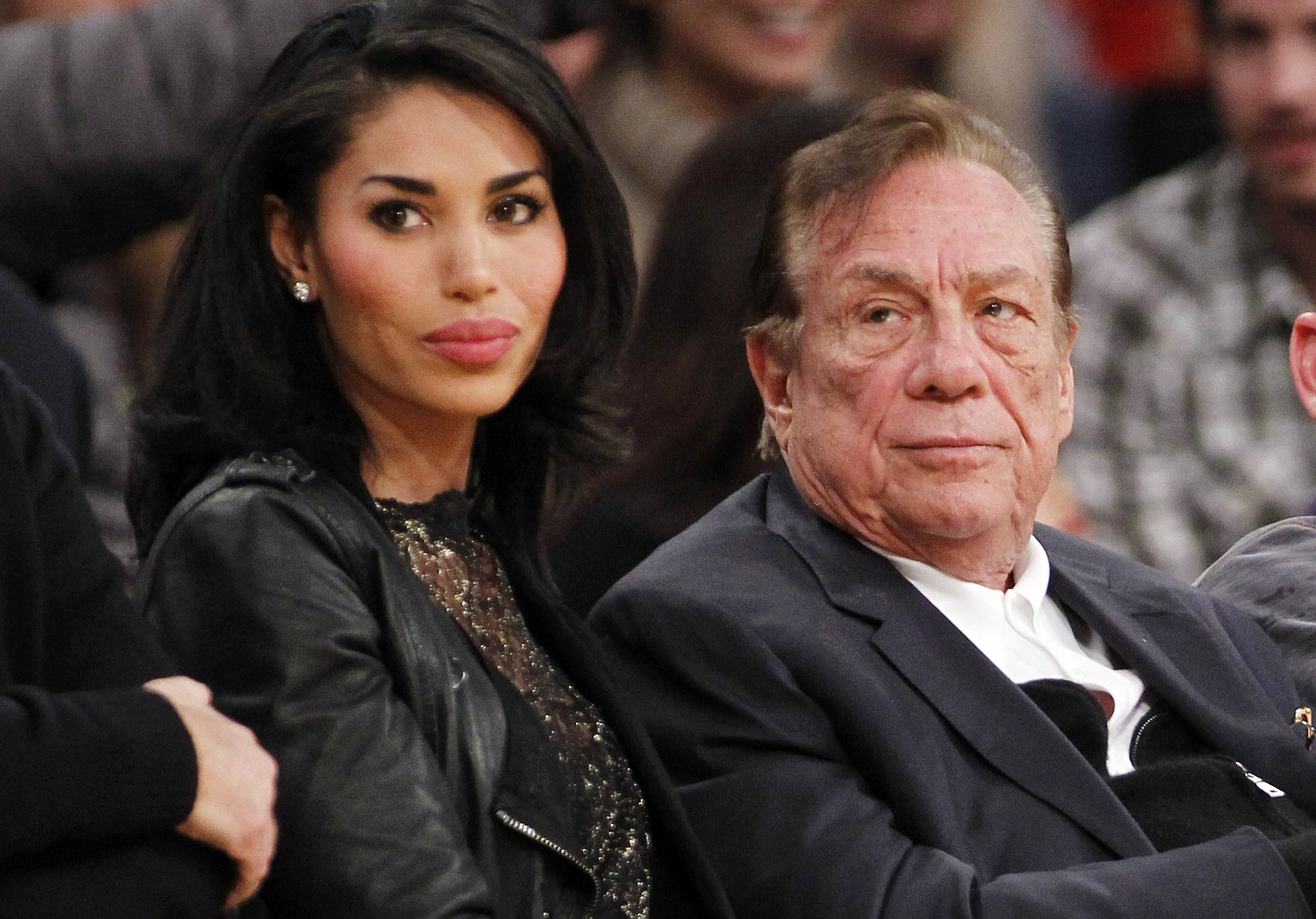 Los Angeles Clippers owner Donald Sterling, right, and V. Stiviano, left. NBA Commissioner Adam Silver announced that Sterling has been banned for life by the NBA.