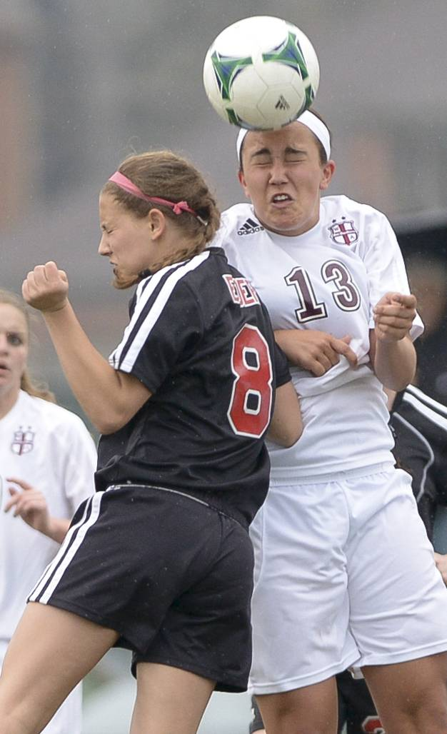 Benet Academy's Loretta Elder and Wheaton Academy's Gabi LaMantia head the ball during Monday's soccer game in West Chicago.