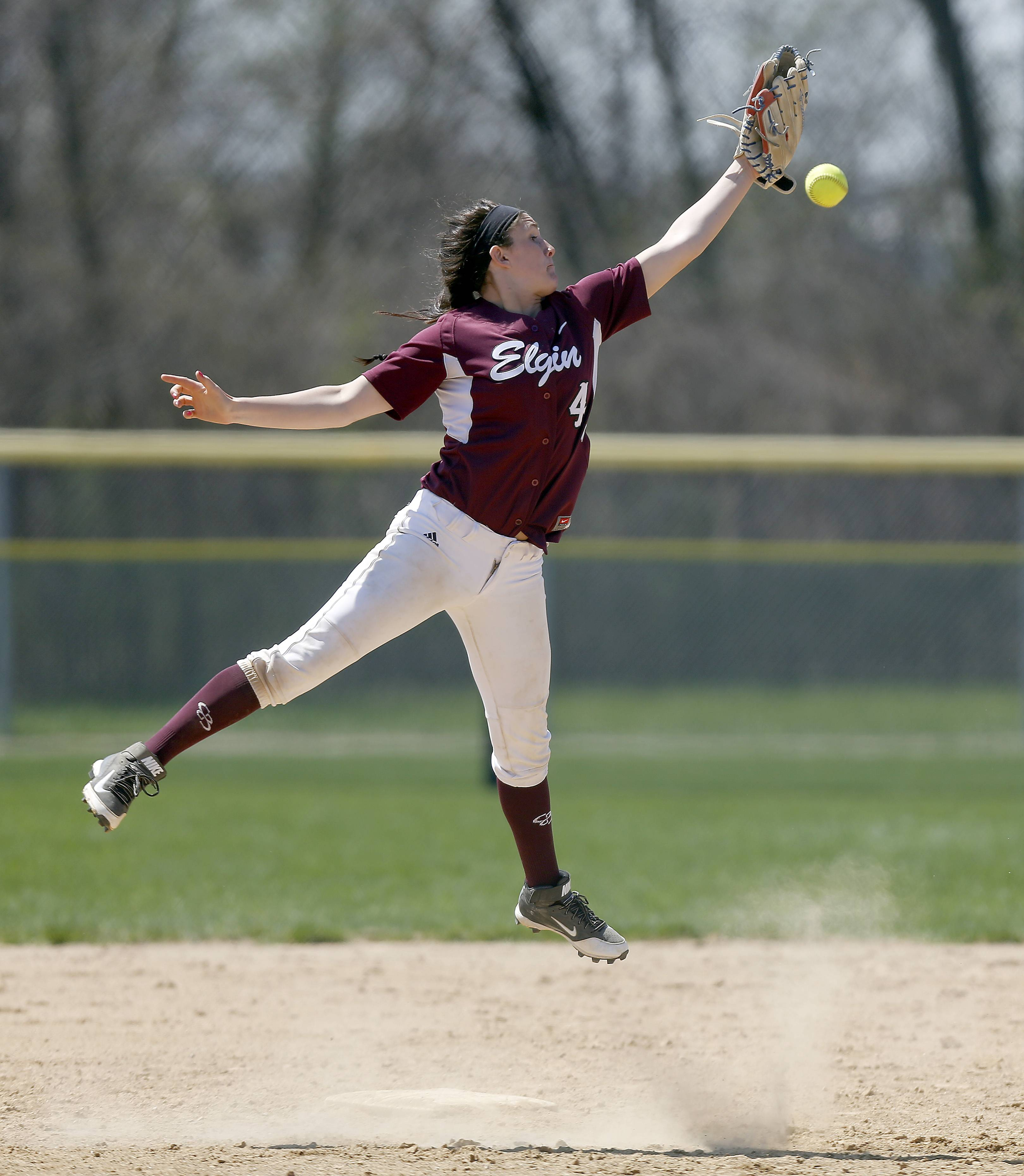 Elgin's Jennah Perryman (4) can't reach a throw to second base against Mt. Assisi during the Larkin Slugfest softball tournament Saturday at the Elgin Sports Complex.