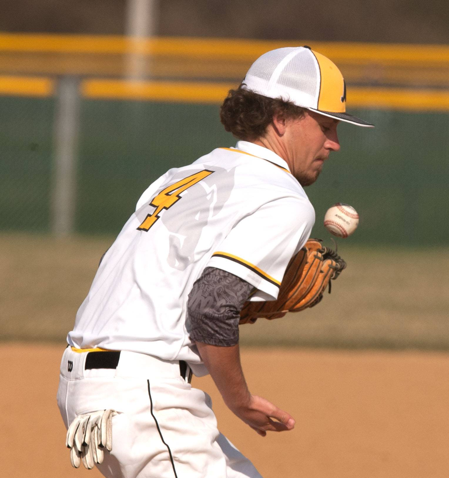 Metea Valley's Derek Kirchner tries to pull in a ground ball against Neuqua Valley in Aurora.