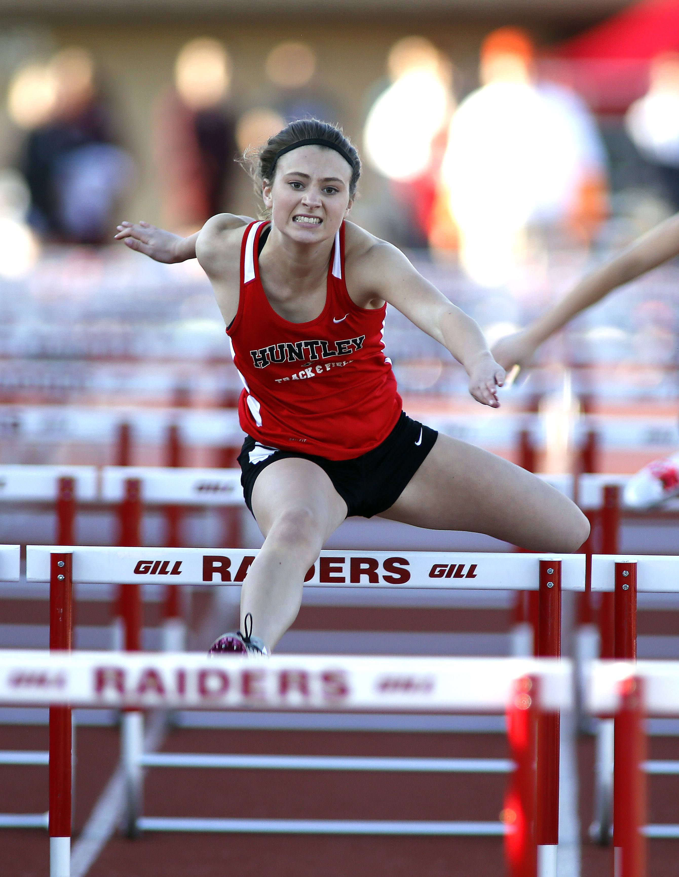 Huntley's Macy Tramblay finishes strong in the 100-meter hurdles at Friday's McHenry County Track and Field Championships in Huntley.