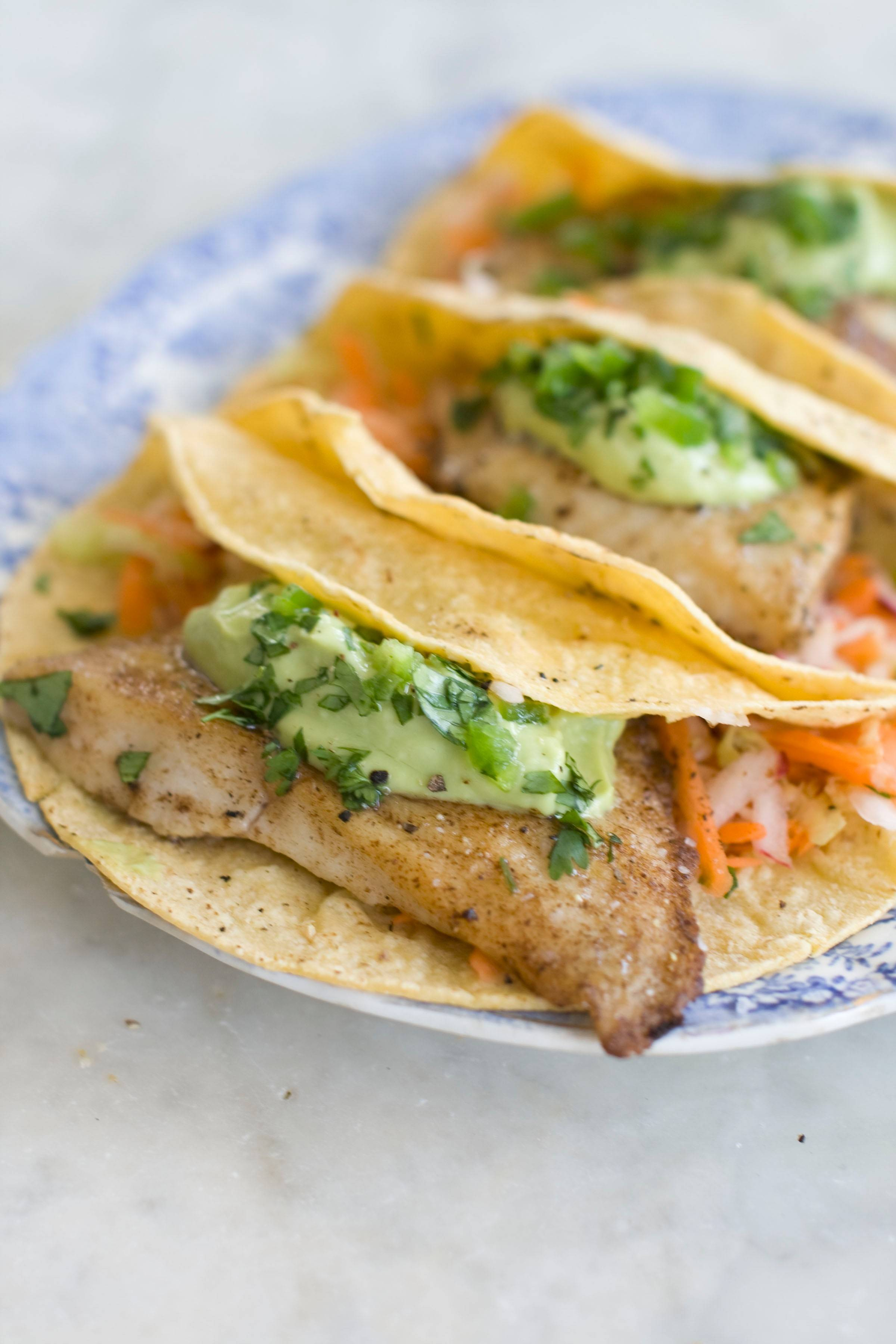 Give your Cinco de Mayo feast a healthy spin with fish tacos topped with avocado cream.