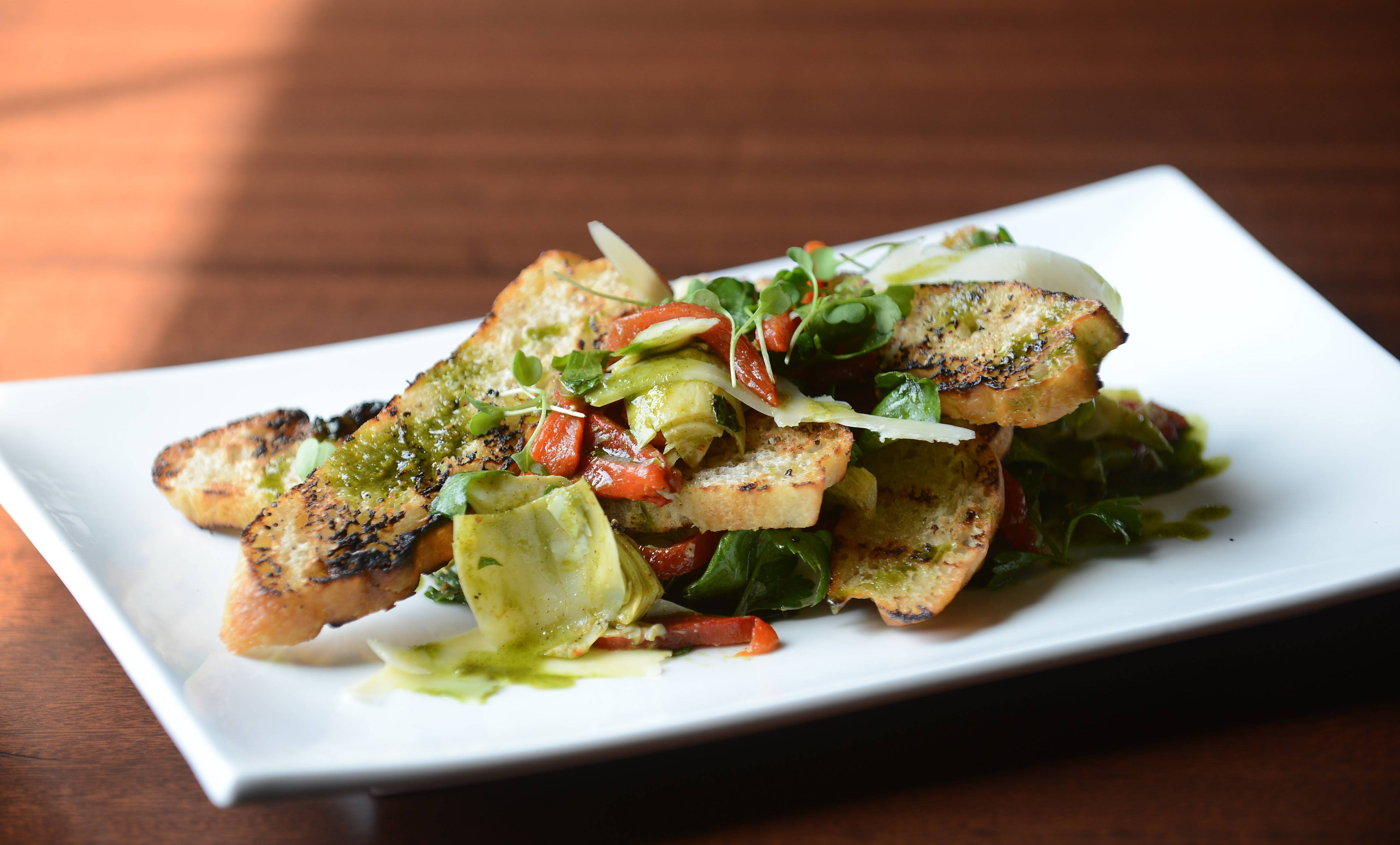Red Heart Salad, named by Chef Chris Ayukawa's pastry chef wife, features marinated artichokes and peppers.