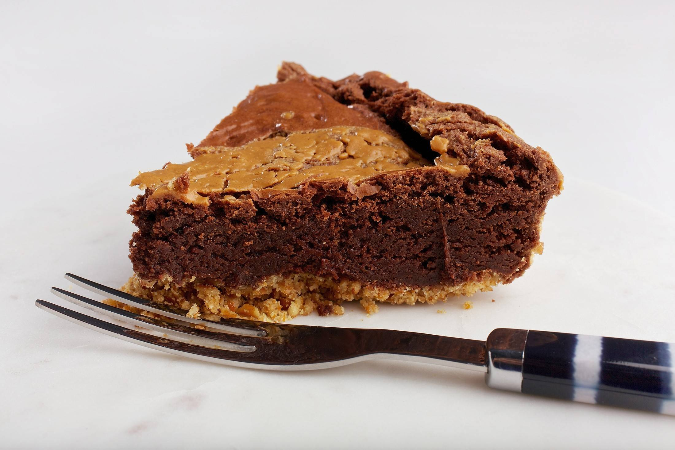 A salty pretzel crust holds together this decadent Peanut Butter Brownie Pie.