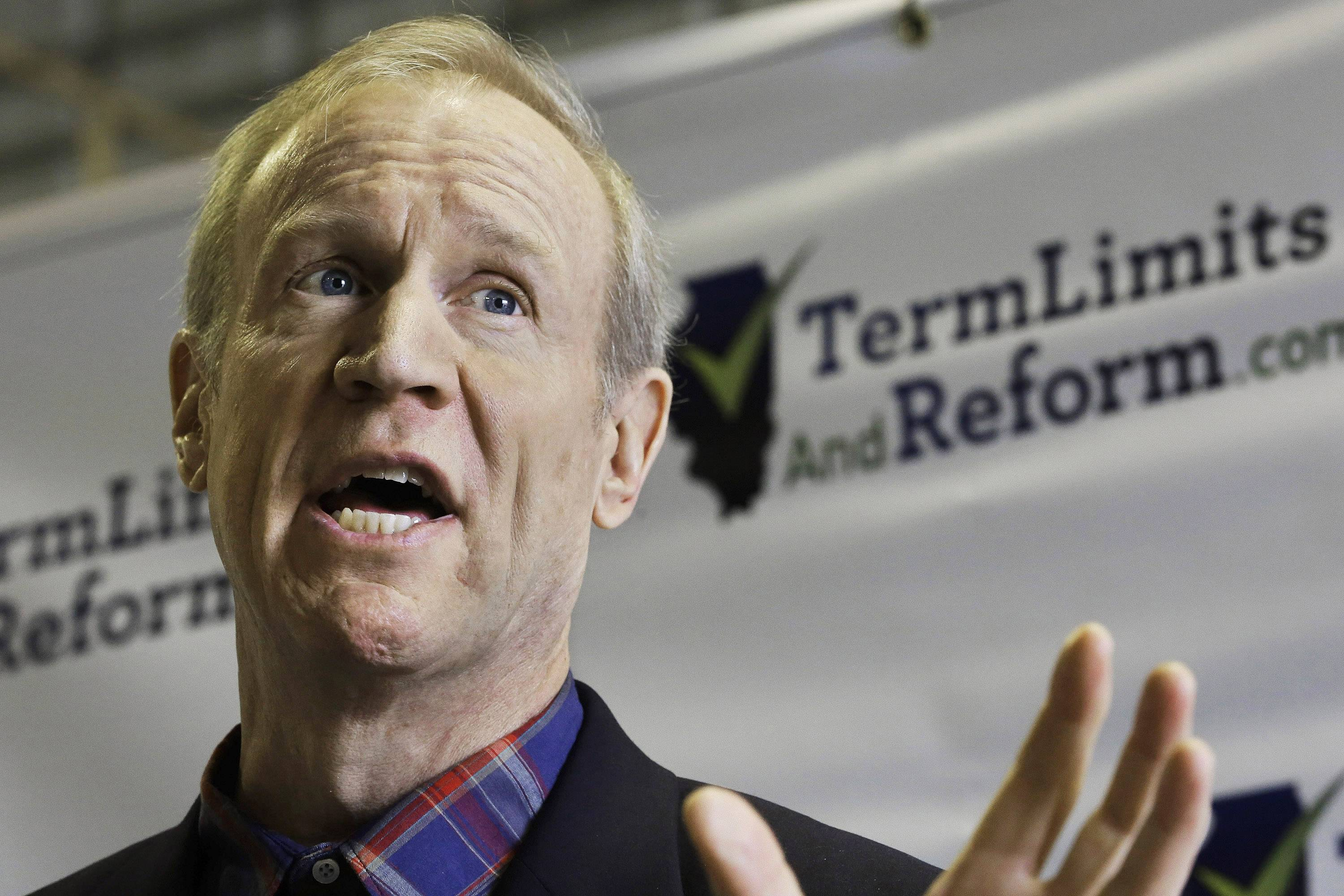 Republican gubernatorial candidate Bruce Rauner speaks to reporters about term limits for lawmakers Wednesday in Springfield.