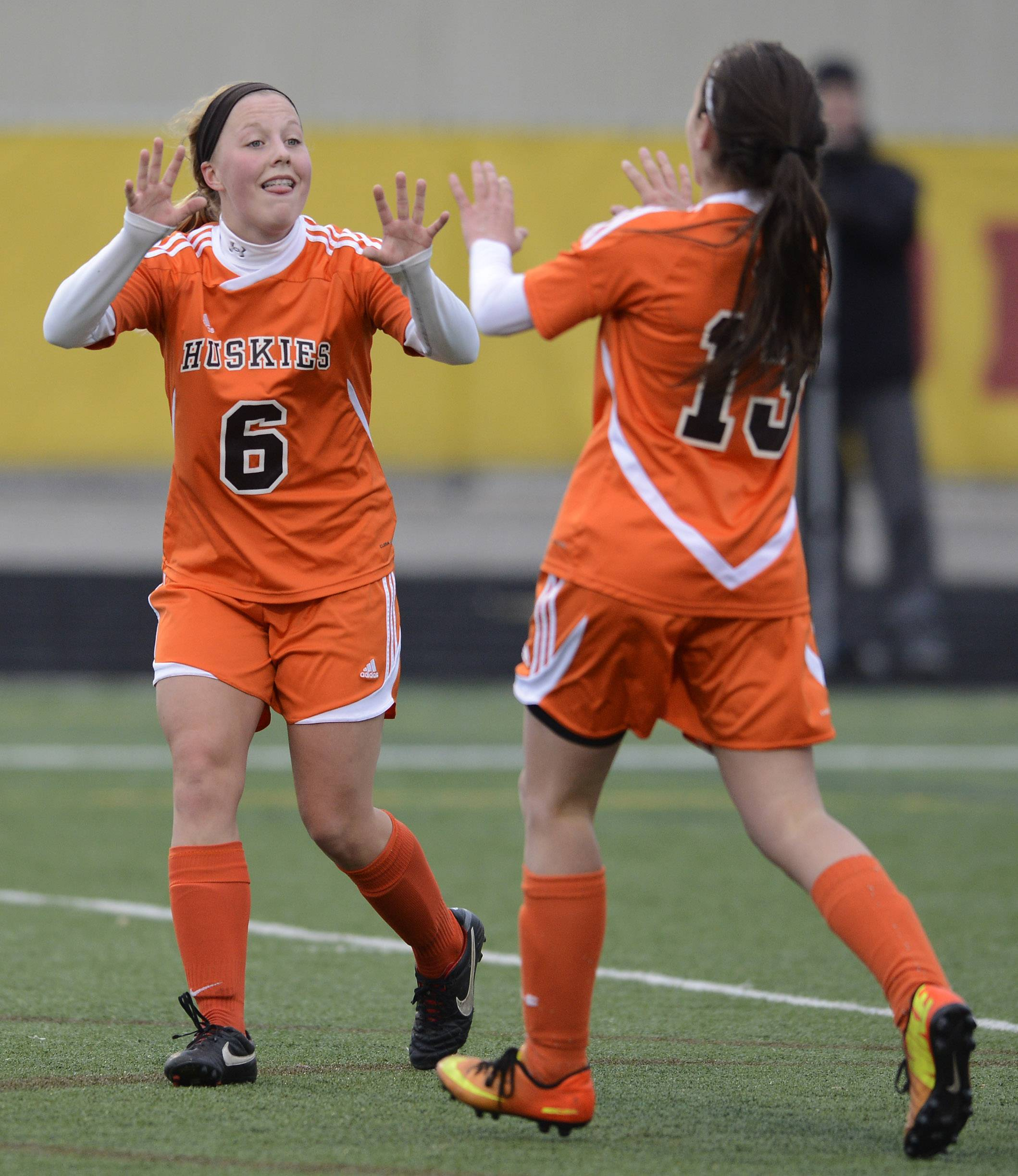 Hersey's Sara Magnuson, left, celebrates her second goal of the game after an assist from teammate Gina Miklasz during Wednesday's game at Schaumburg.