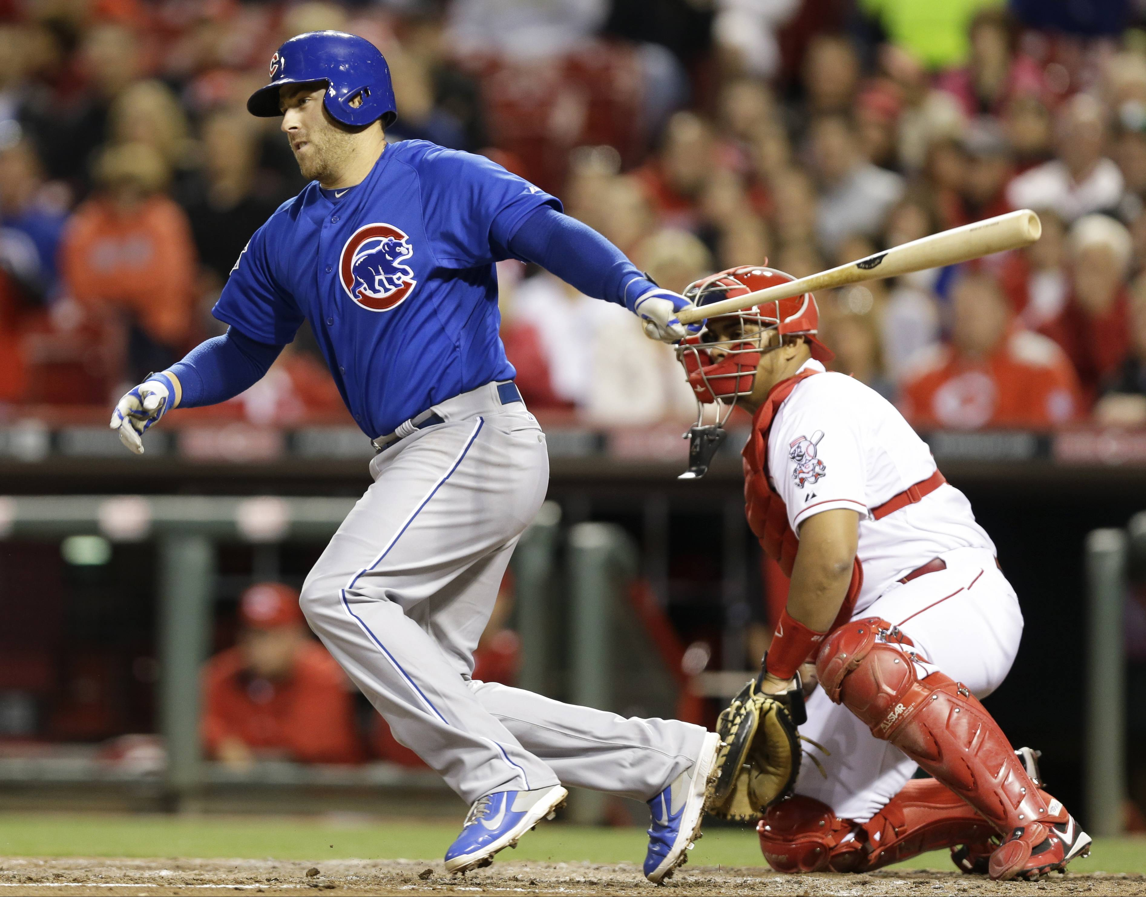 Chicago Cubs' Mike Olt drives in a run in the fifth inning of a baseball game against the Cincinnati Reds, Wednesday, April 30, 2014, in Cincinnati. Brayan Pena catches at right. (AP Photo)