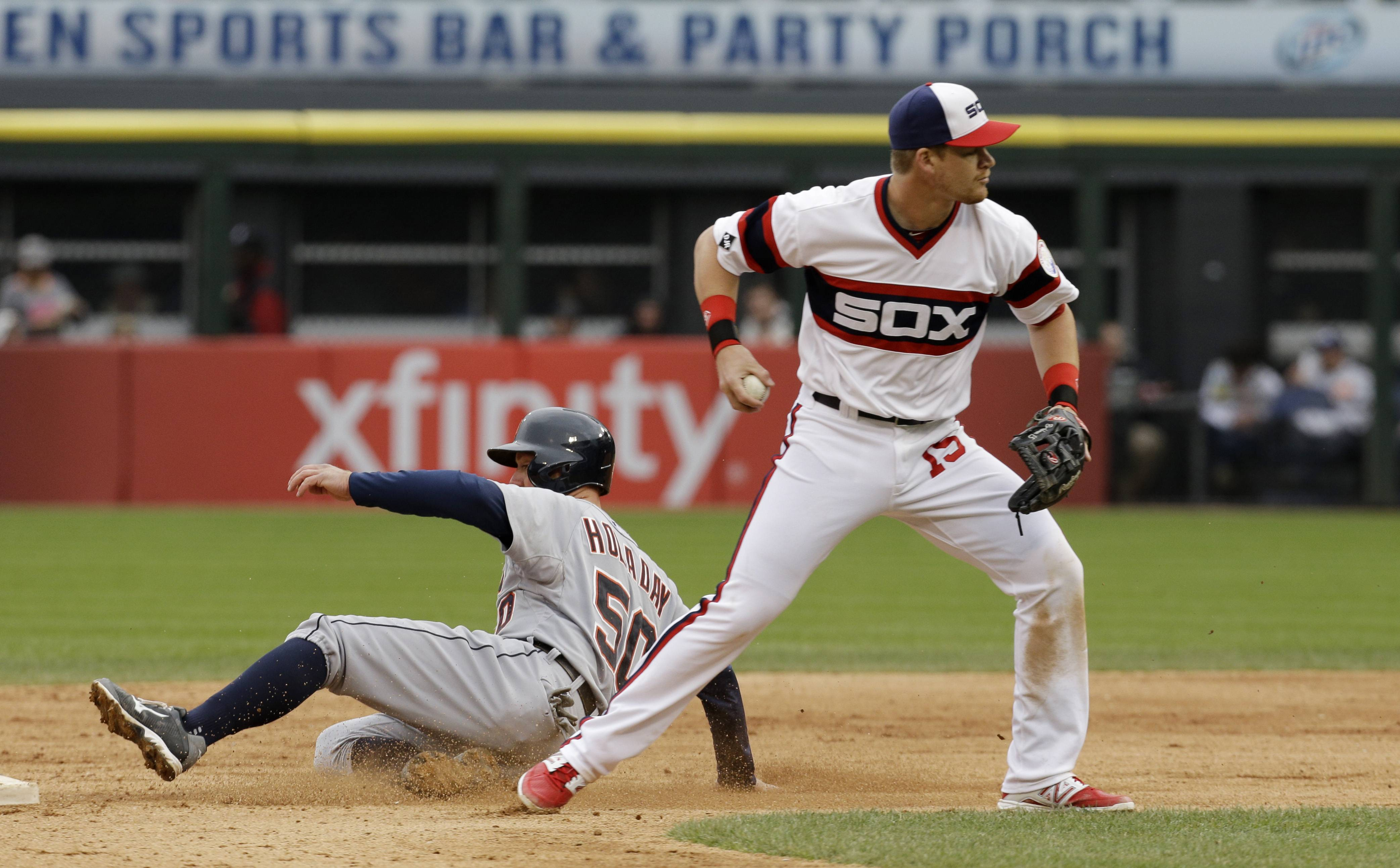 Detroit Tigers' Bryan Holaday, left, is safe at second base as Chicago White Sox second baseman Gordon Beckham looks to a throw during the ninth inning of a baseball game in Chicago on Wednesday, April 30, 2014. The Tigers won 5-1. (AP Photo/Nam Y. Huh)