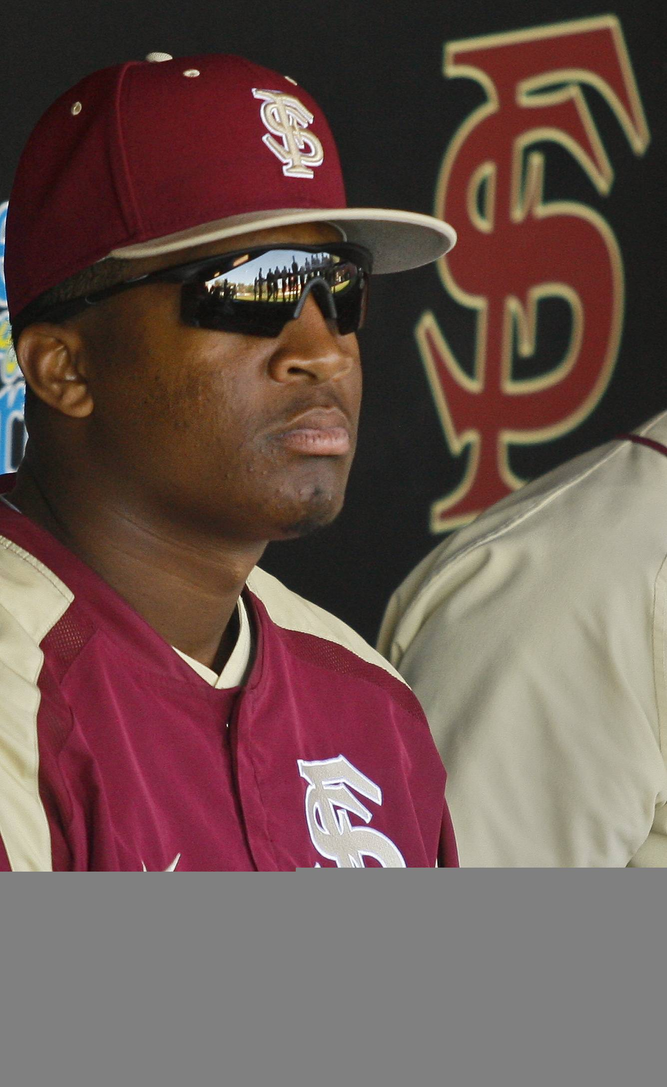 FILE - In this March 2, 2014, file photo, Florida State relief pitcher Jameis Winston sits in the dugout in the sixth inning of an NCAA college baseball game against Miami in Tallahassee, Fla. The Florida State baseball team has indefinitely suspended Heisman Trophy winner Jameis Winston, who is a relief pitcher for the Seminoles. Baseball coach Mike Martin said in a statement Wednesday, April 30, 2014, that Winston was issued a citation the night before, but he did not give specifics. The Leon County Sheriff's Office has declined comment. (AP Photo/Phil Sears, File)