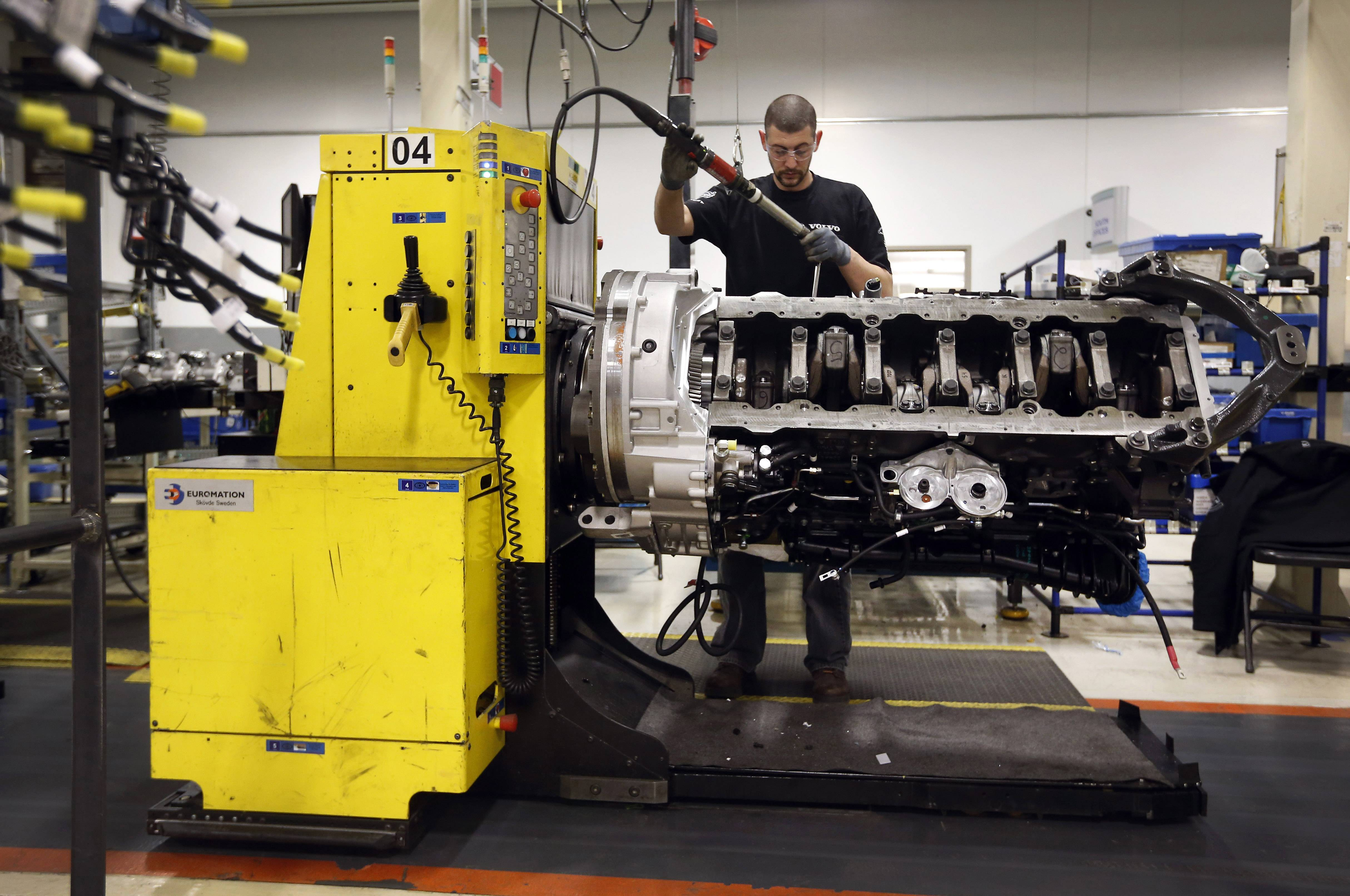 Jon Wyand works on a truck engine assembly line at Volvo Trucks' powertrain manufacturing facility in Hagerstown, Md. The economy likely stumbled at the start of this year, but there's probably little reason to worry: Economists foresee a solid rebound with the end of a harsh winter.