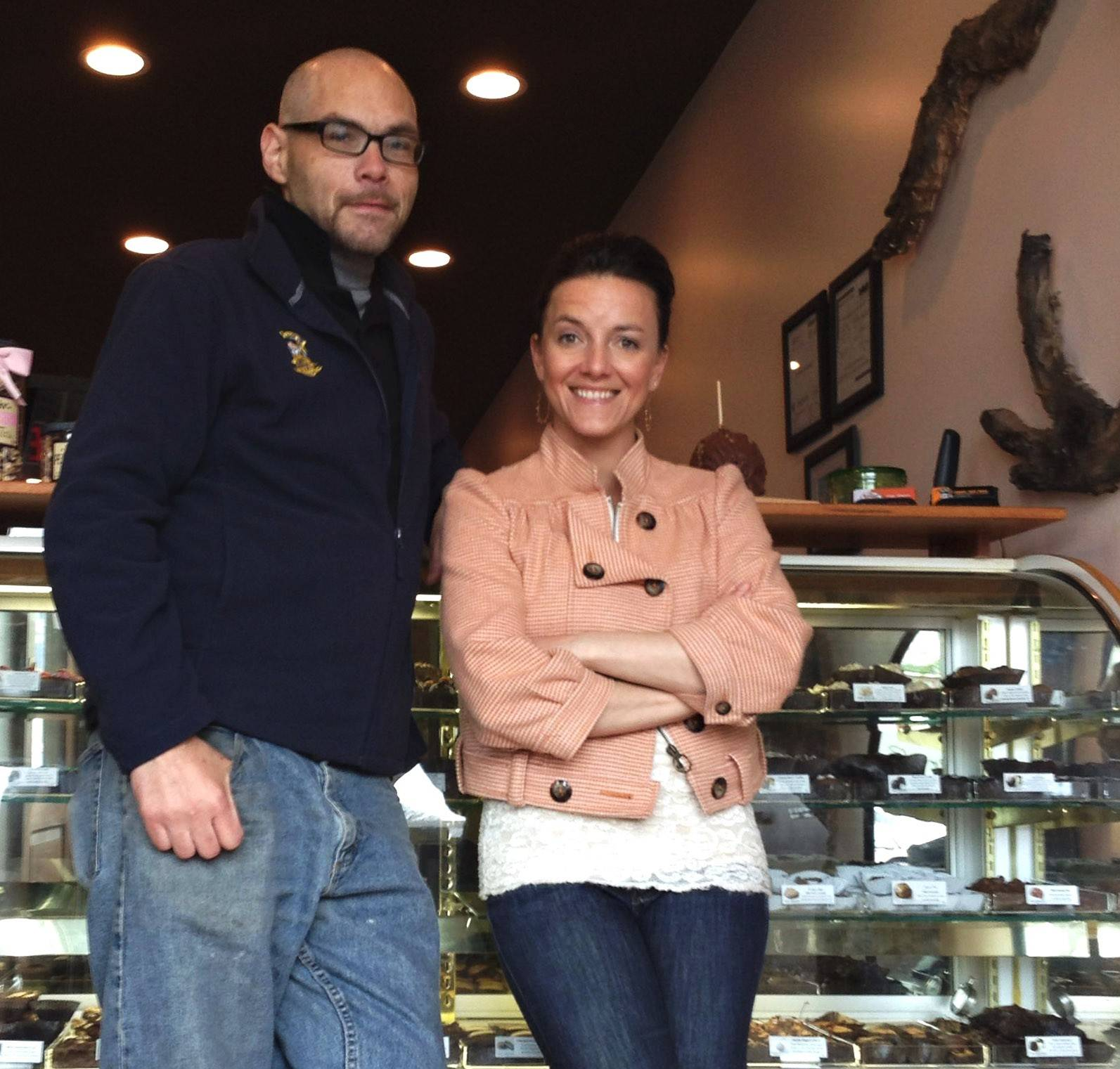 "Robert ""Buzz"" Doyle, left, Kelli Keyzers and their partner Patrick Maggi, not shown, opened Sweet Pop Fizz Candy Bar, a candy shop that also offers soda, gifts, wine and beer, in downtown East Dundee. This summer, the trio will also open a barbecue restaurant half a block away from Sweet Pop Fizz Candy Bar."