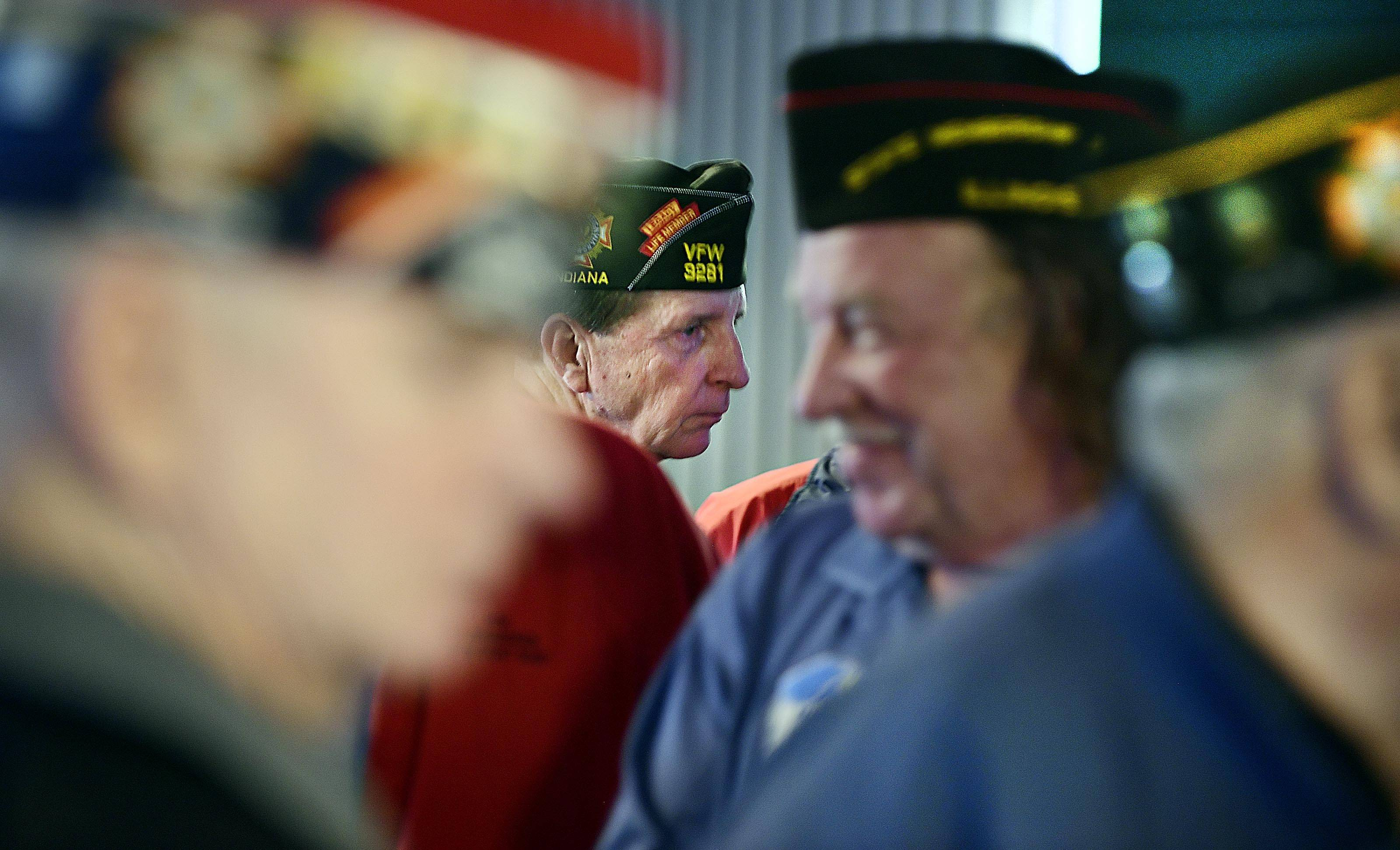 John Starks/jstarks@dailyherald.comBill Thien, Commander-in Chief of the Veterans of Foreign Wars of the United States, meets other veterans and listens to questions at the Elgin Watch City VFW Post 1307 Tuesday.