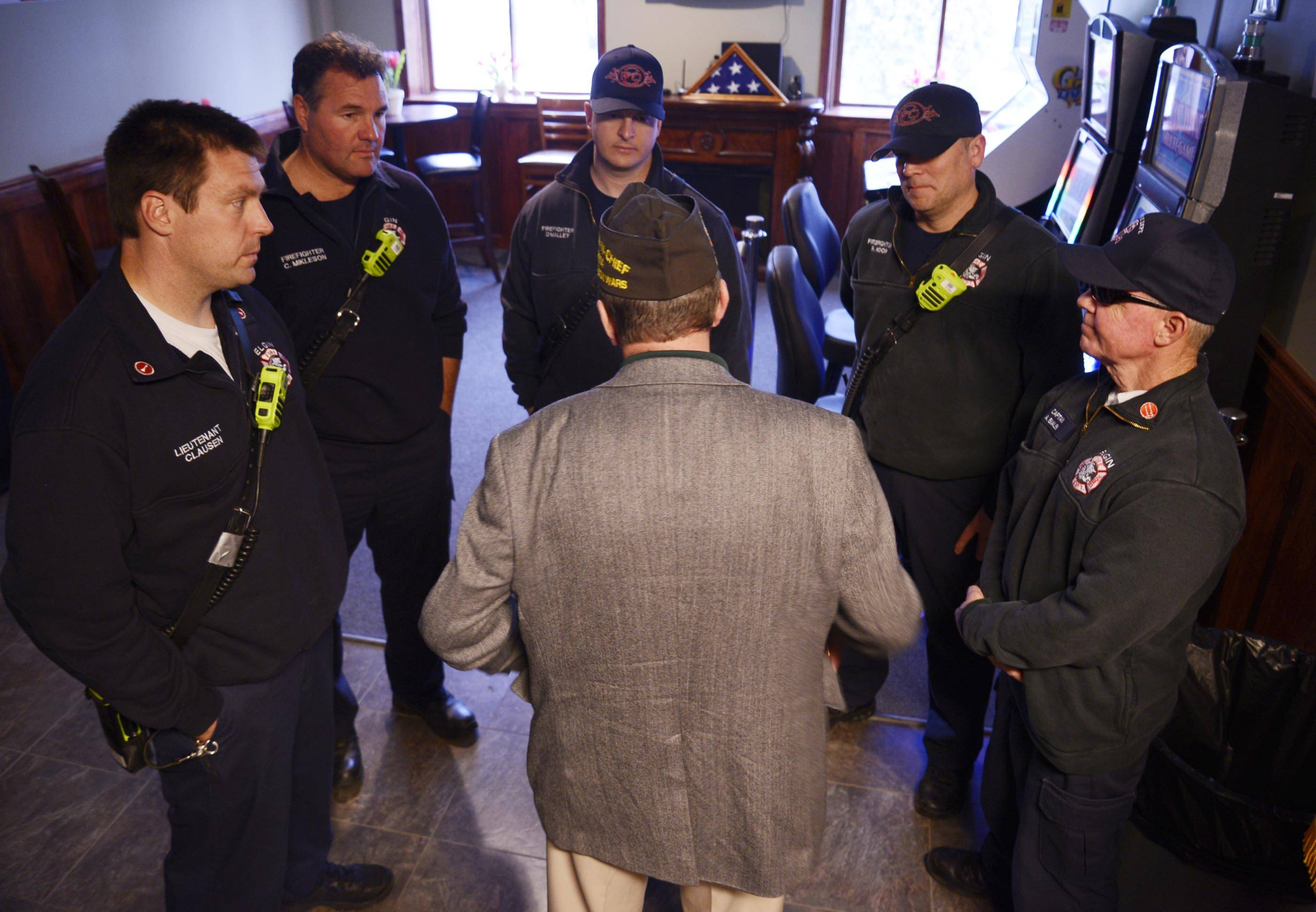 John Starks/jstarks@dailyherald.comBill Thien, Commander-in Chief of the Veterans of Foreign Wars of the United States, talks with a group of Elgin firefighters at the Elgin Watch City VFW Post 1307 Tuesday.