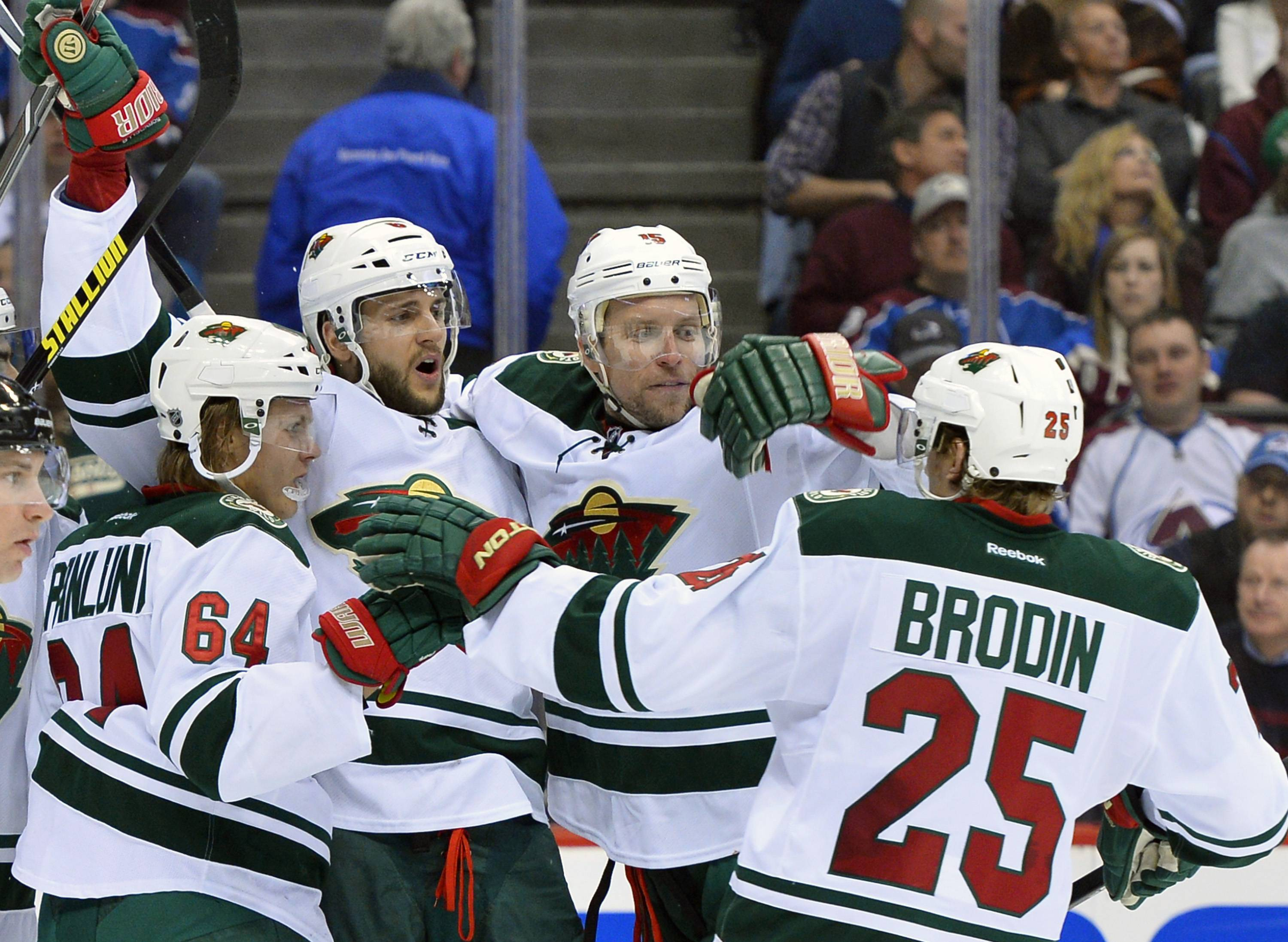 Minnesota Wild's Mikael Granlund (64), Marco Scandella (6), and Jonas Brodin (25) celebrate Dany Heatley's (15) goal against the Colorado Avalanche in the second period during Game 7 of an NHL hockey first-round playoff series on Wednesday, April 30, 2014, in Denver.