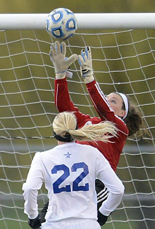 Geneva goalkeeper Sam Hauser stretches to make a stop in front of St. Charles North's Sophie Pohl Wednesday in St. Charles.