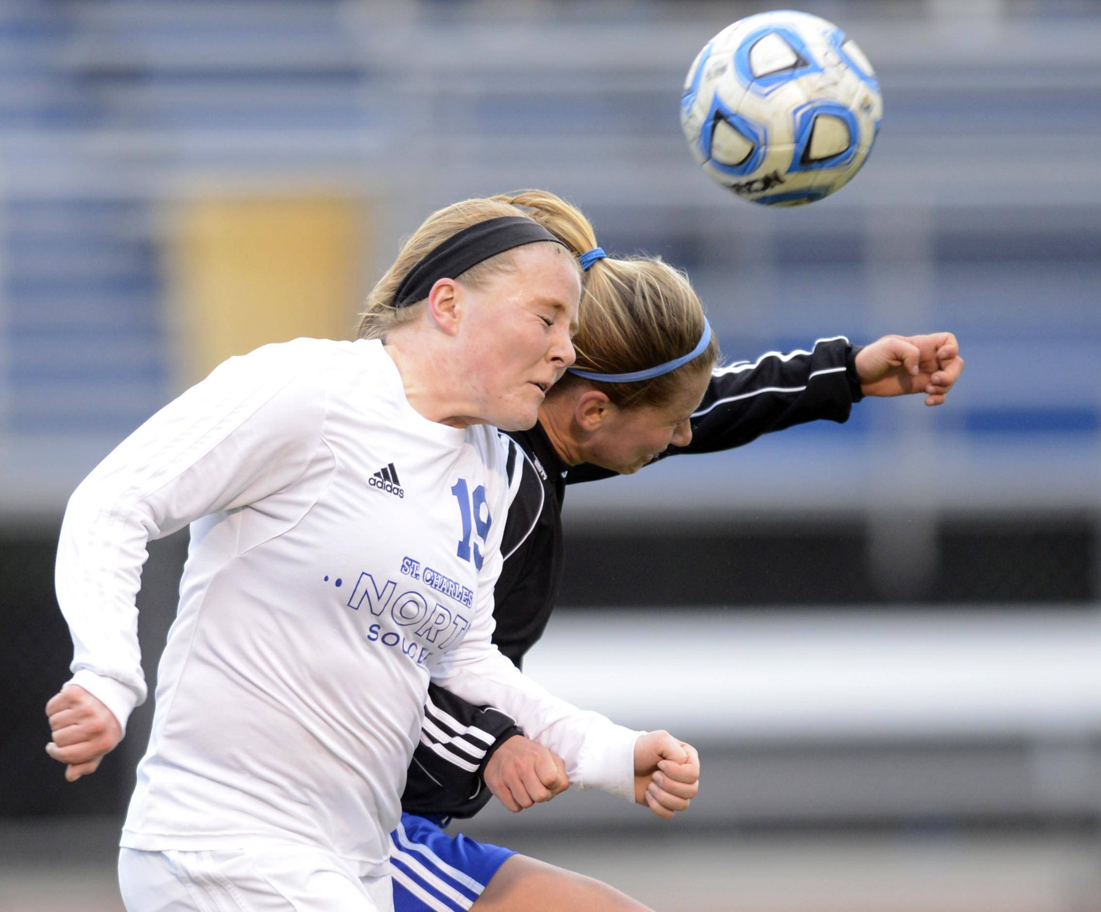St. Charles North's Megan O'Leary and Geneva's Mary Landry race for a header Wednesday in St. Charles.