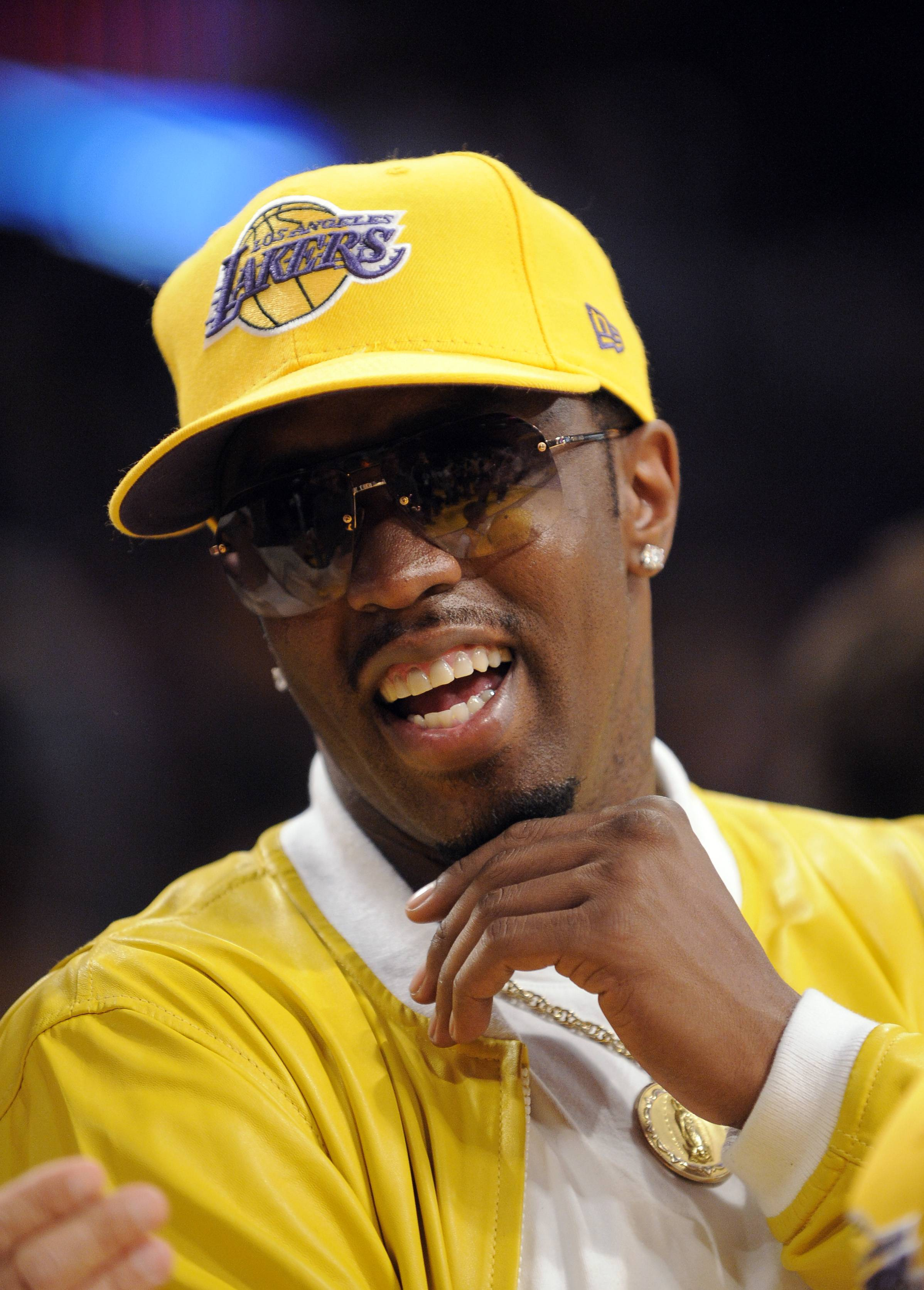 FILE - In this June 7, 2009, file photo, Music mogul Sean Combs sits courtside during the first half of Game 2 of the NBA basketball finals between the Los Angeles Lakers and Orlando Magic in Los Angeles. If Donald Sterling is compelled to sell the Los Angeles Clippers, the list of potential buyers will have more stars than the team's roster. Combs tweeted his interest in going after the Clippers.
