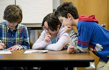 Students from Friendship, Grove and Holmes Junior High schools worked together to answer science questions, and complete an activity that simulated a real-life science problem during the fifth annual District 59 Junior High Science Bowl.