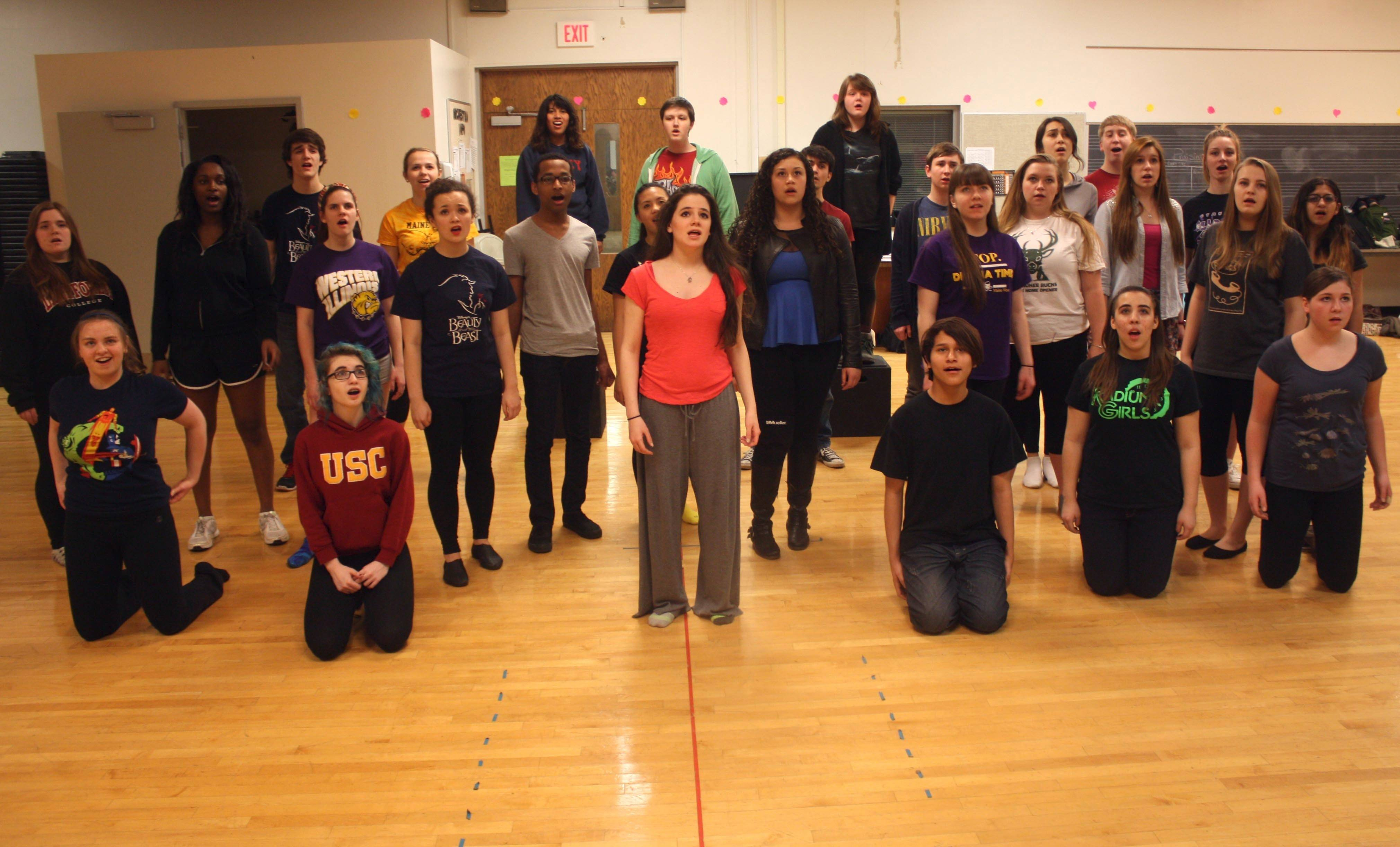 "Elizabeth Stenholt, center in red shirt, rehearses with the ensemble for the upcoming production of ""Aida."""
