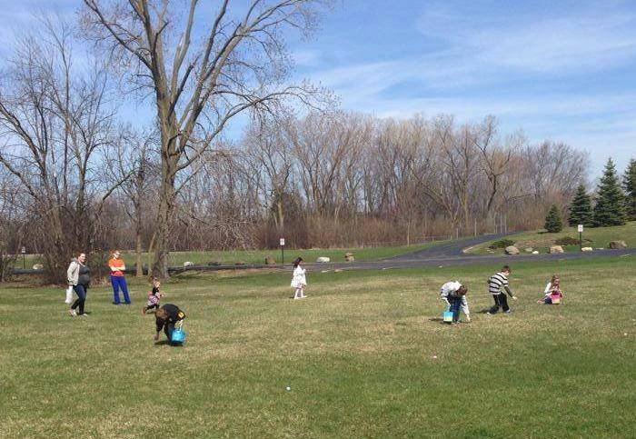 Children hunt for eggs at the Animal Hospital of Lake Villa's Therapy Reading and Egg Hunt event Saturday, April 19.