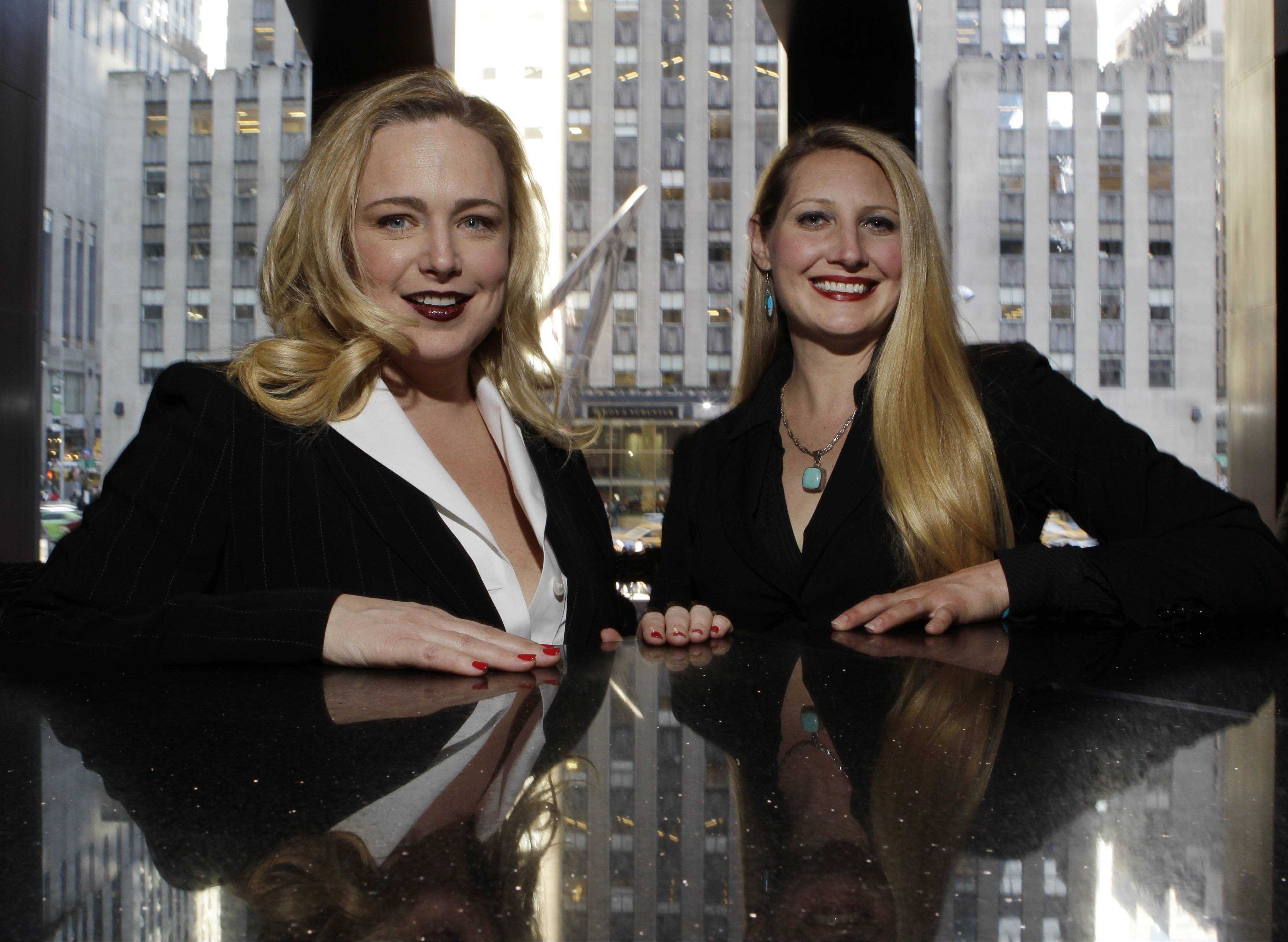 Crystl Faye Horton-Friedman, right, and Kristin Beckler, left, pose for a photo at Del Frisco's in New York. Both women work as sommeliers at the restaurant. More women are moving up the wine ranks, said Dorothy Cann Hamilton, founder and CEO of the International Culinary Center.