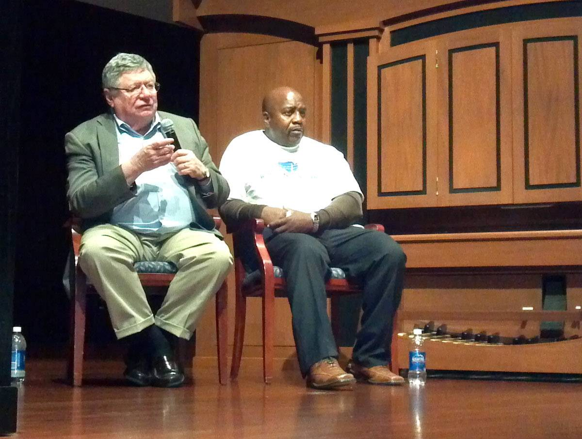 "Rob Warden, award-winning journalist and executive director of the Center on Wrongful Convictions at Northwestern University, answers a question at the end of ""From Death Row to Freedom: An Innocent Man's Journey"" in 2012 at Aurora University. Nathson ""Nate"" Fields, right, spoke about his experience on death row fighting a wrongful conviction for a double murder."