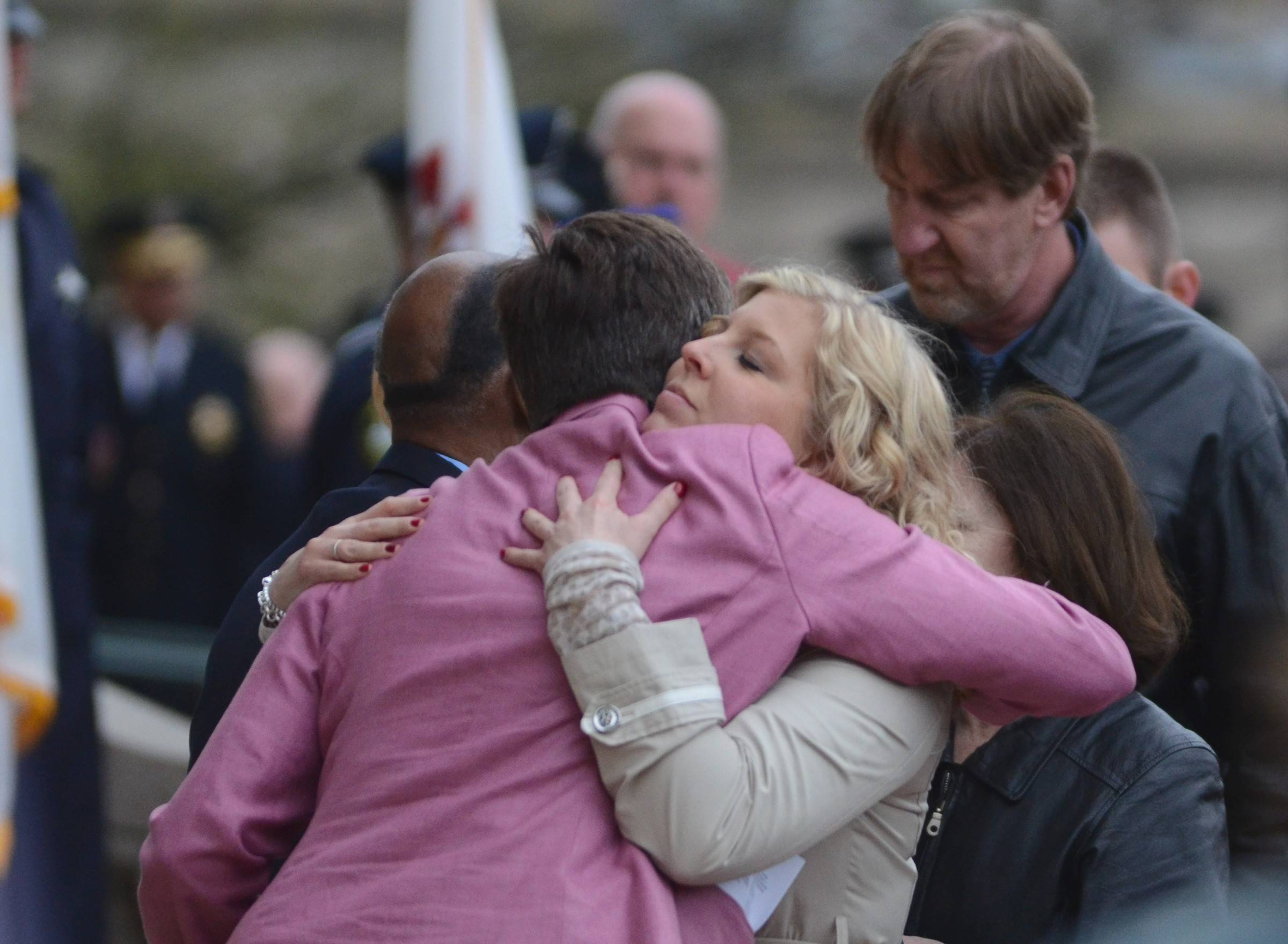 Elizabeth Sauter, widow of deceased Illinois State Police trooper James Sauter, shares a hug with Lt. Gov. Sheila Simon before receiving a plaque in her husband's honor.