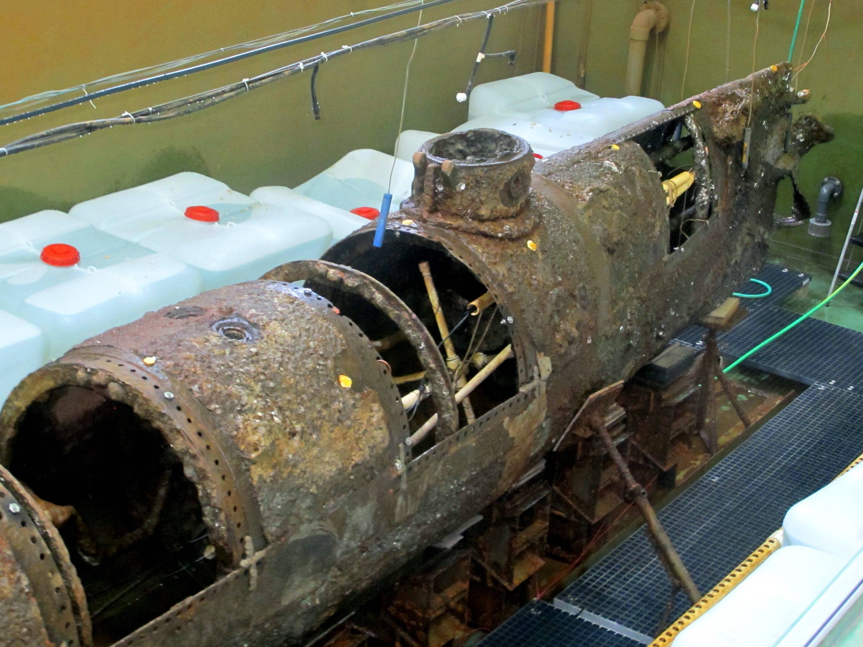 The Confederate submarine H.L. Hunley sits in a conservation tank at a lab in North Charleston, S.C., before it was to be covered in a chemical bath on Thursday.