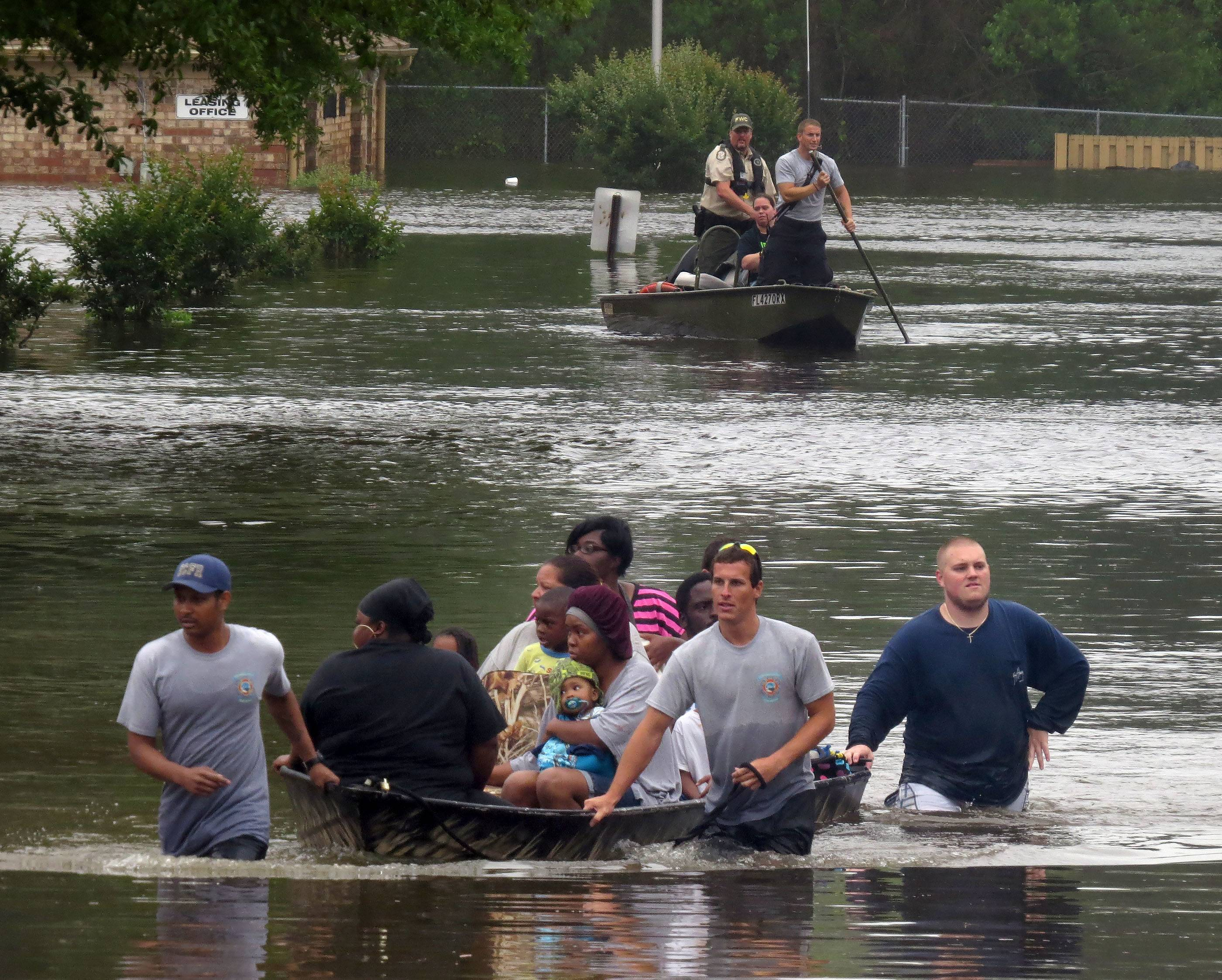 Dozens of residents at the Forest Creek Apartments in Pensacola, Fla., had to be ferried to safety Wednesday.