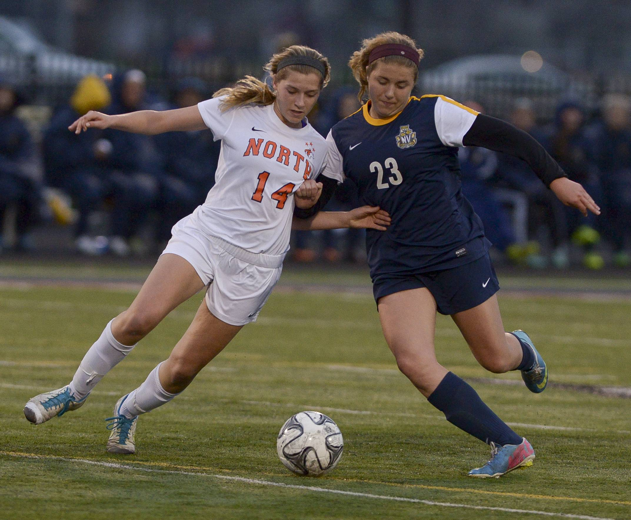 Naperville North's Olivia Stapelton Neuqua Valley's Allie Fullreide battle for control of the ball during the 2014 Naperville girls soccer invitational, Thursday.
