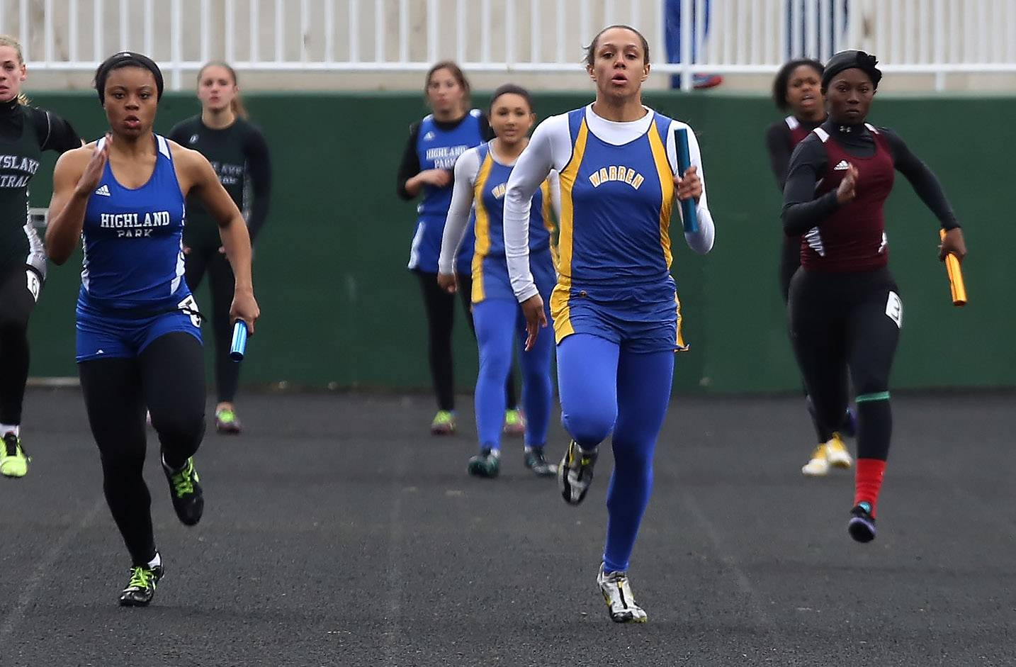 Warren sprinter Brittny Ellis, middle, leads the field to win the 4x100-meter relay during the Lake County Invite on Thursday at Grayslake Central.
