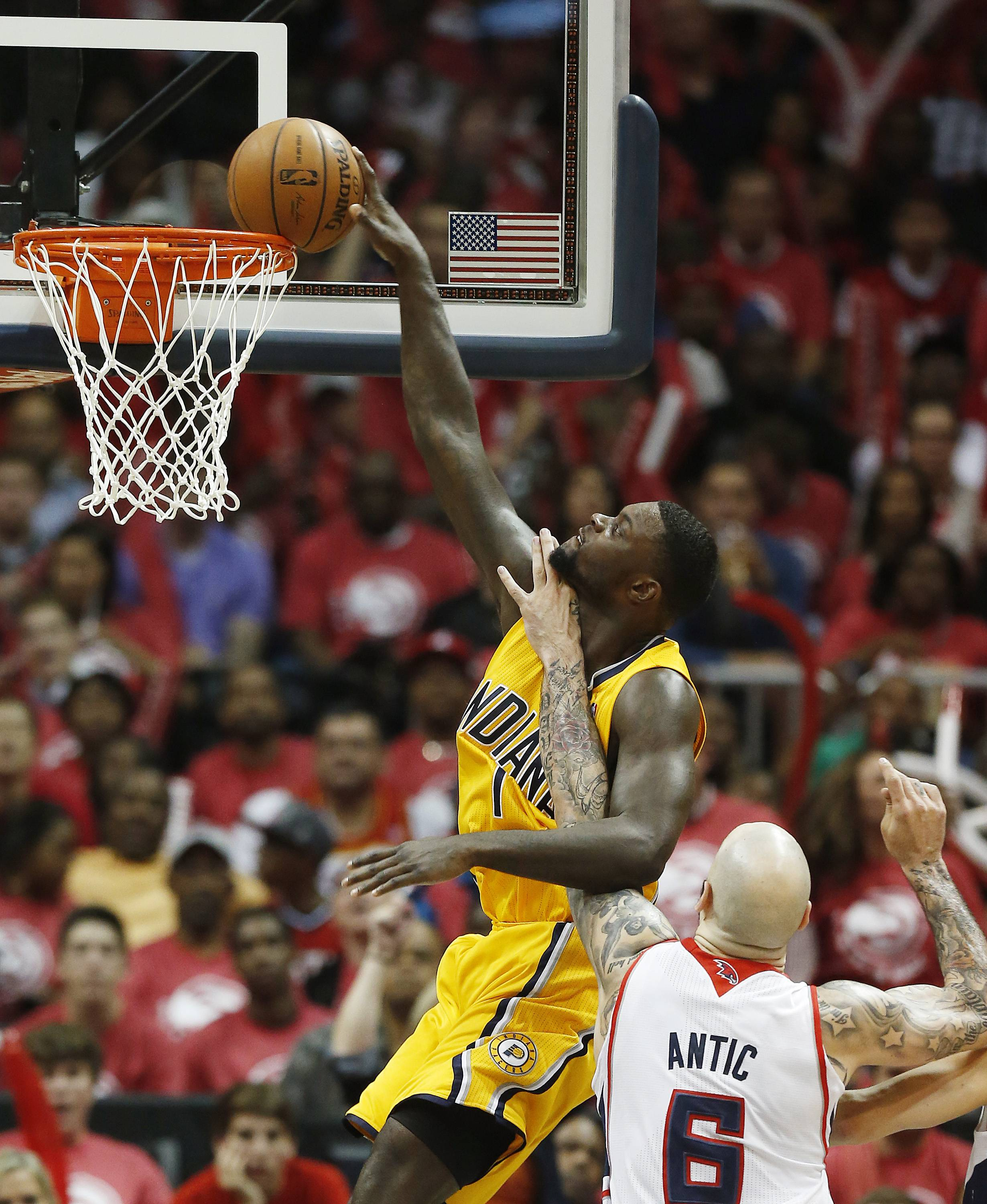 Indiana Pacers guard Lance Stephenson (1) is fouled by Atlanta Hawks center Pero Antic (6) while trying to score in the second half of Game 6 of a first-round NBA basketball playoff series in Atlanta, Thursday, May 1, 2014. Indiana won 95-88. (AP Photo/John Bazemore)