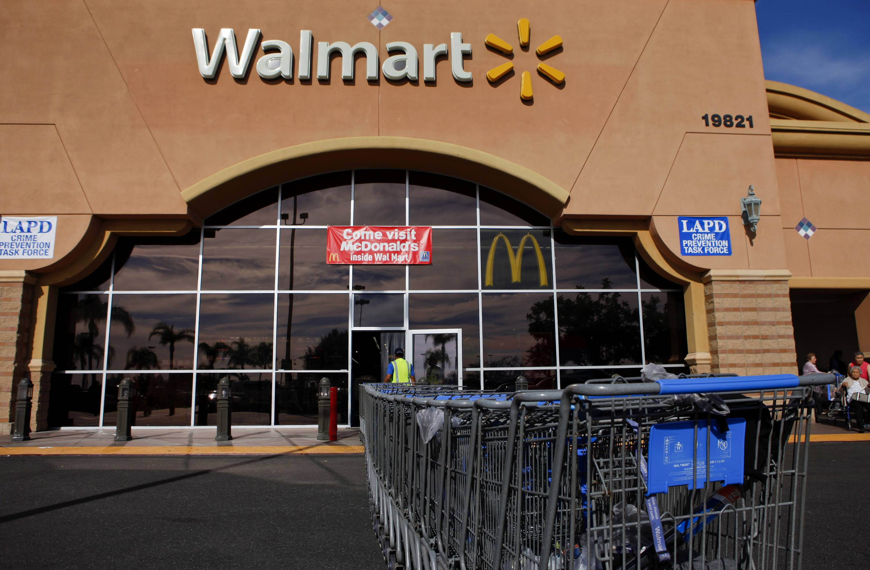 "Wal-Mart says that almost anything is possible as it pushes to cement its reputation as a place where shoppers can stop in for grocery staples like milk and eggs and also cross off a number of other things on their ""To-Do"" list."