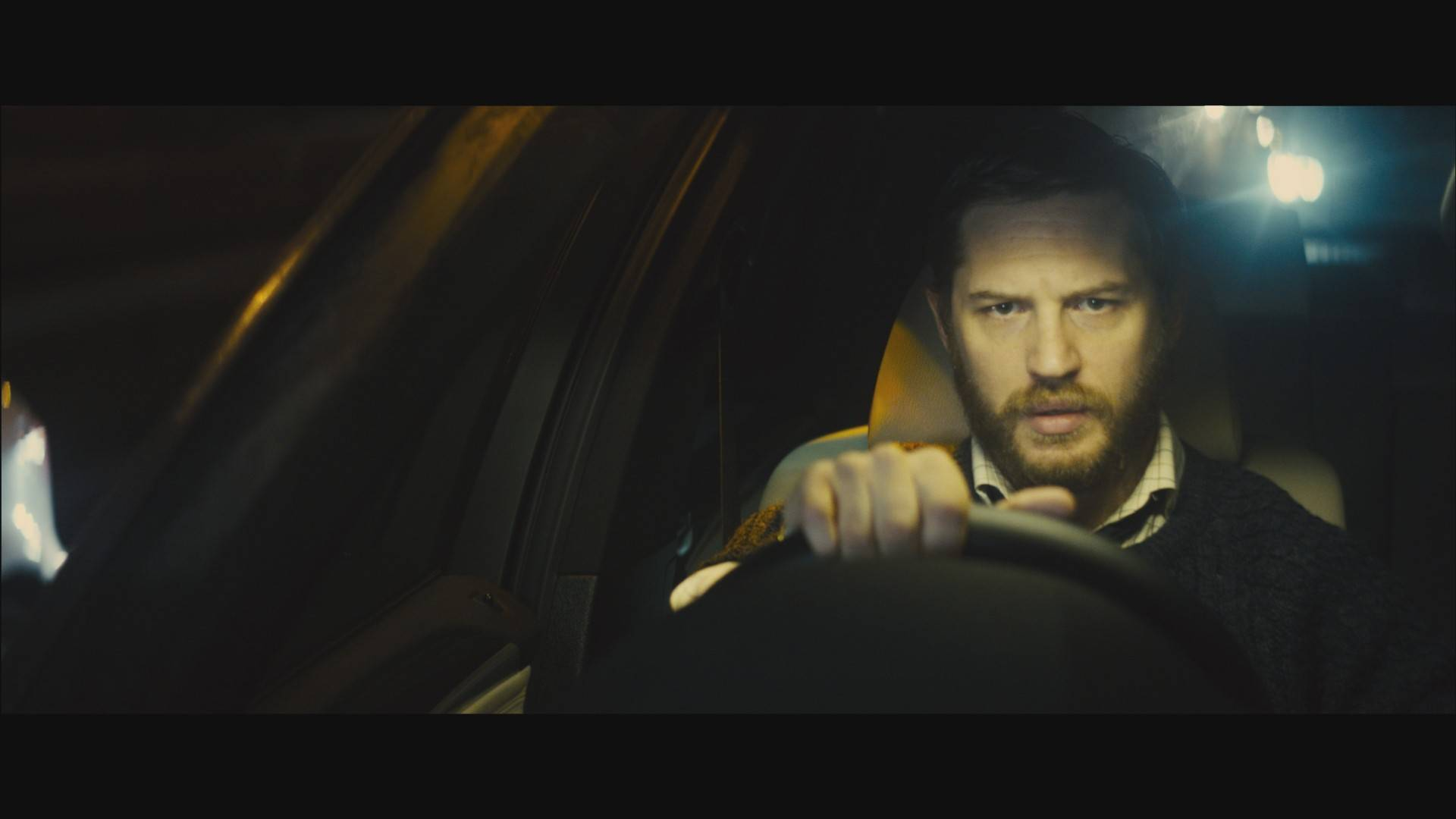 "Ivan Locke (Tom Hardy) confronts a series of life-altering complications over an evening's drive in the daring drama ""Locke."""