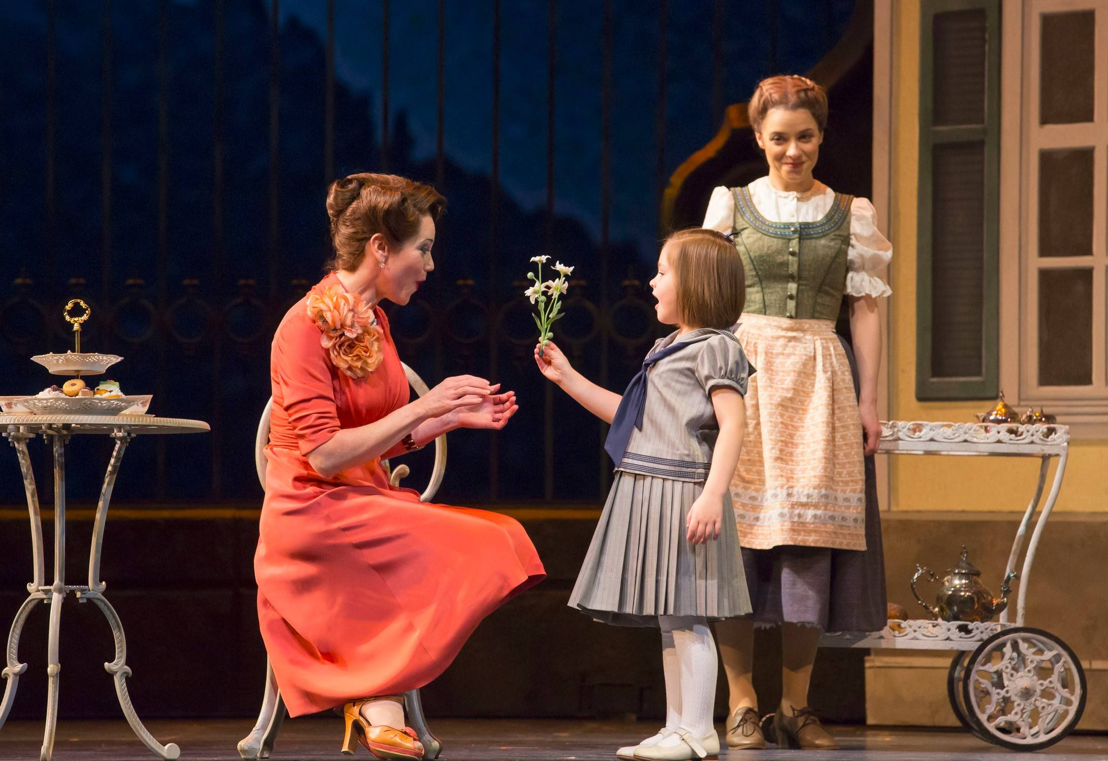 "Under the watchful eye of Maria (Jenn Gambatese), right, Gretl (Nicole Scimeca), second from left, greets Elsa, the woman who may become her new mother (Elizabeth Futral), left, in ""The Sound of Music,"" running through May 25 at the Lyric Opera of Chicago."