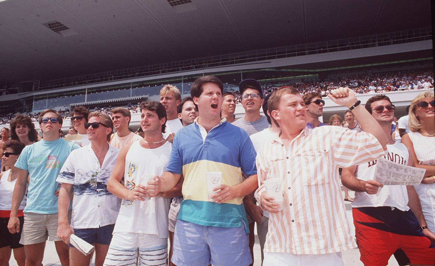 Fans cheer for their favorite at grand opening new Arlington International Racecourse  on July 1, 1989.