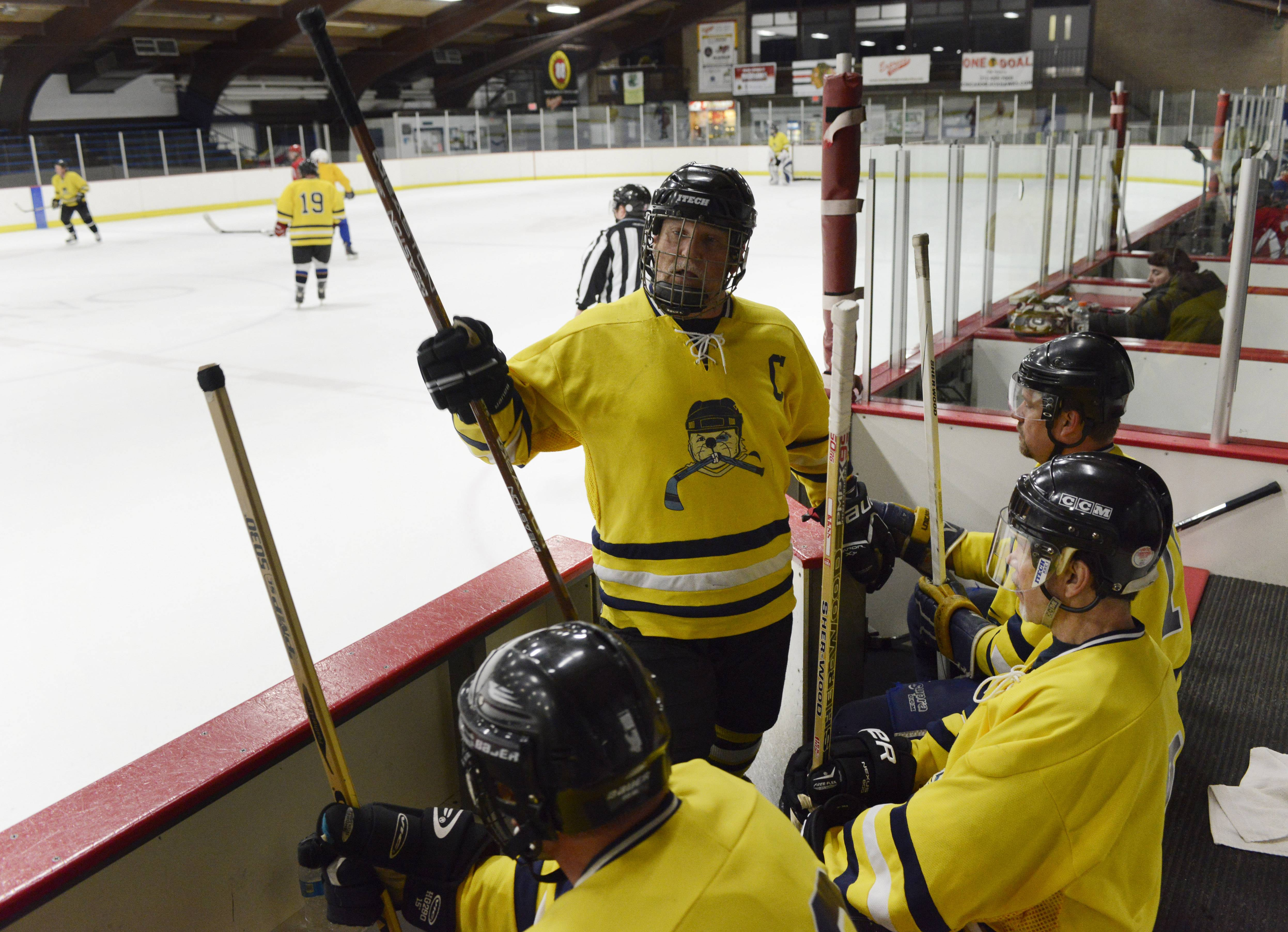 "Gerry Dudziak of Rolling Meadows, the captain of ""Gerry's Kids,"" an over-40 hockey team, leads his team during a game in Park Ridge."