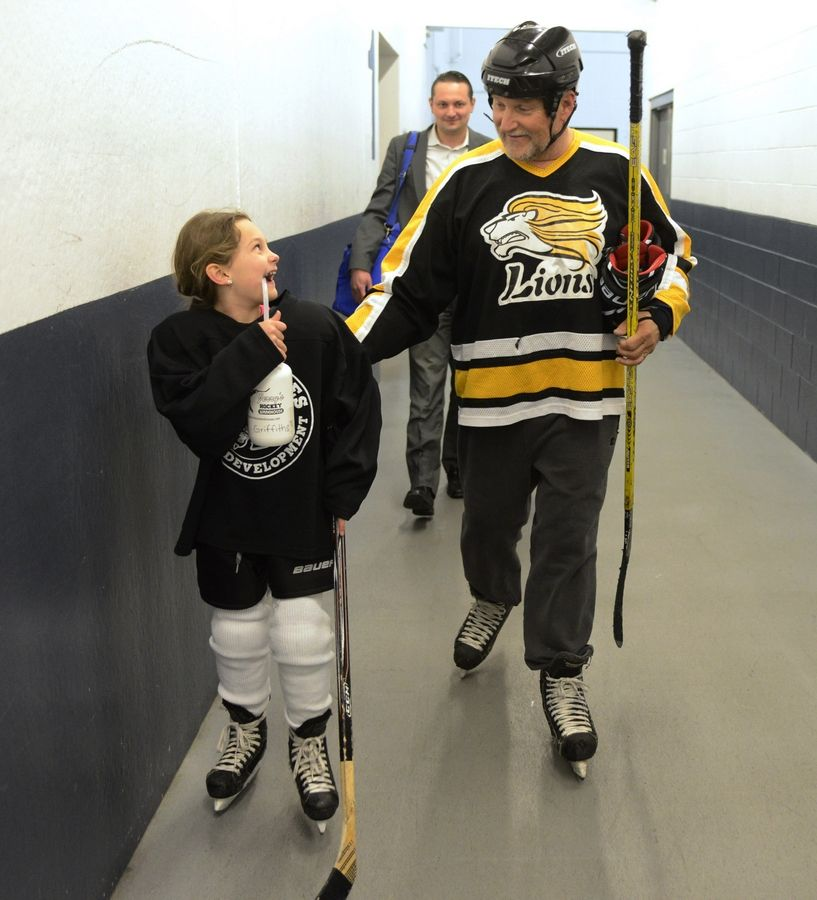Dudziak laughs with his granddaughter, Nina Griffiths, after practice.