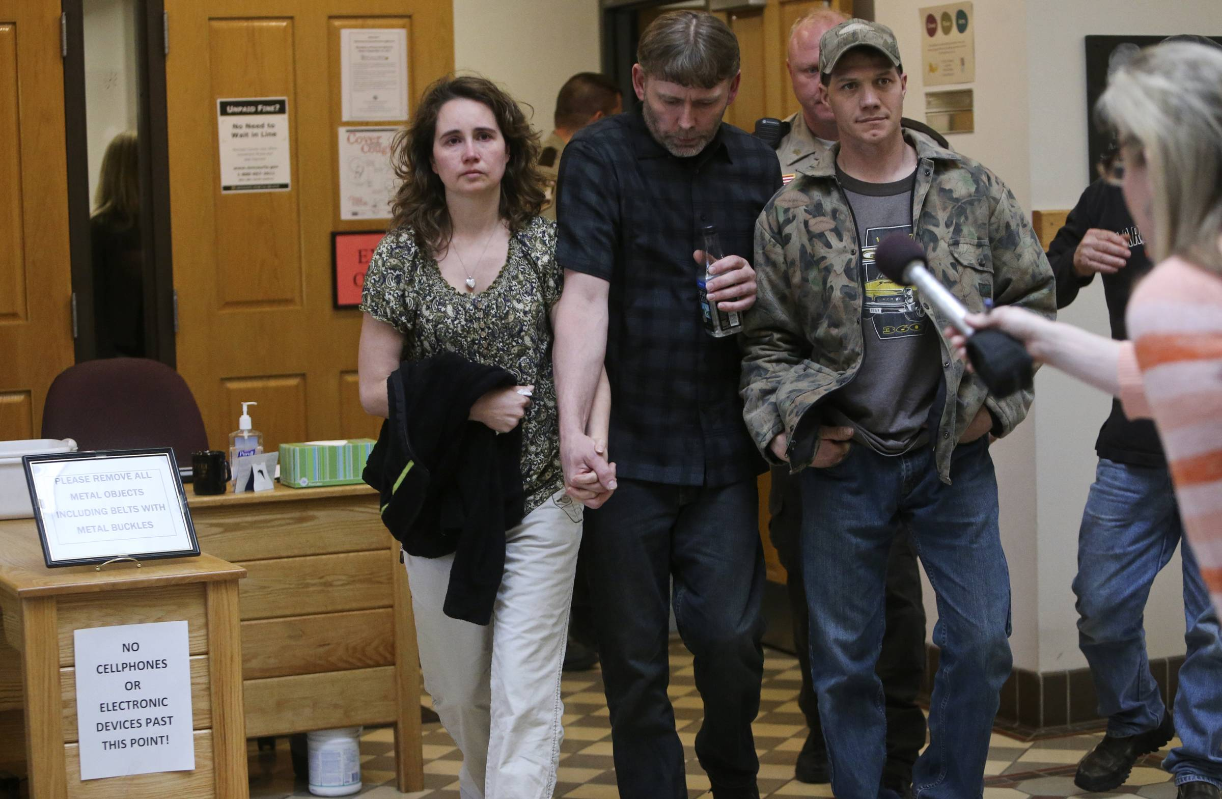 Jenny and Jay Kifer, the parents of Hailey Kifer, leave the courtroom after Byron Smith was found guilty in the murders of Nick Brady and Hailey at the Morrison County Courthouse in Little Falls, Minn.