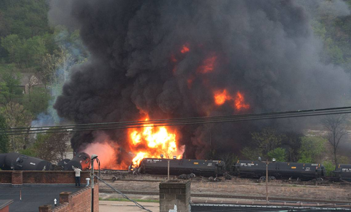 Several CSX tanker cars carrying crude oil in flames after derailing in downtown Lynchburg, Va., Wednesday, April 30, 2014.