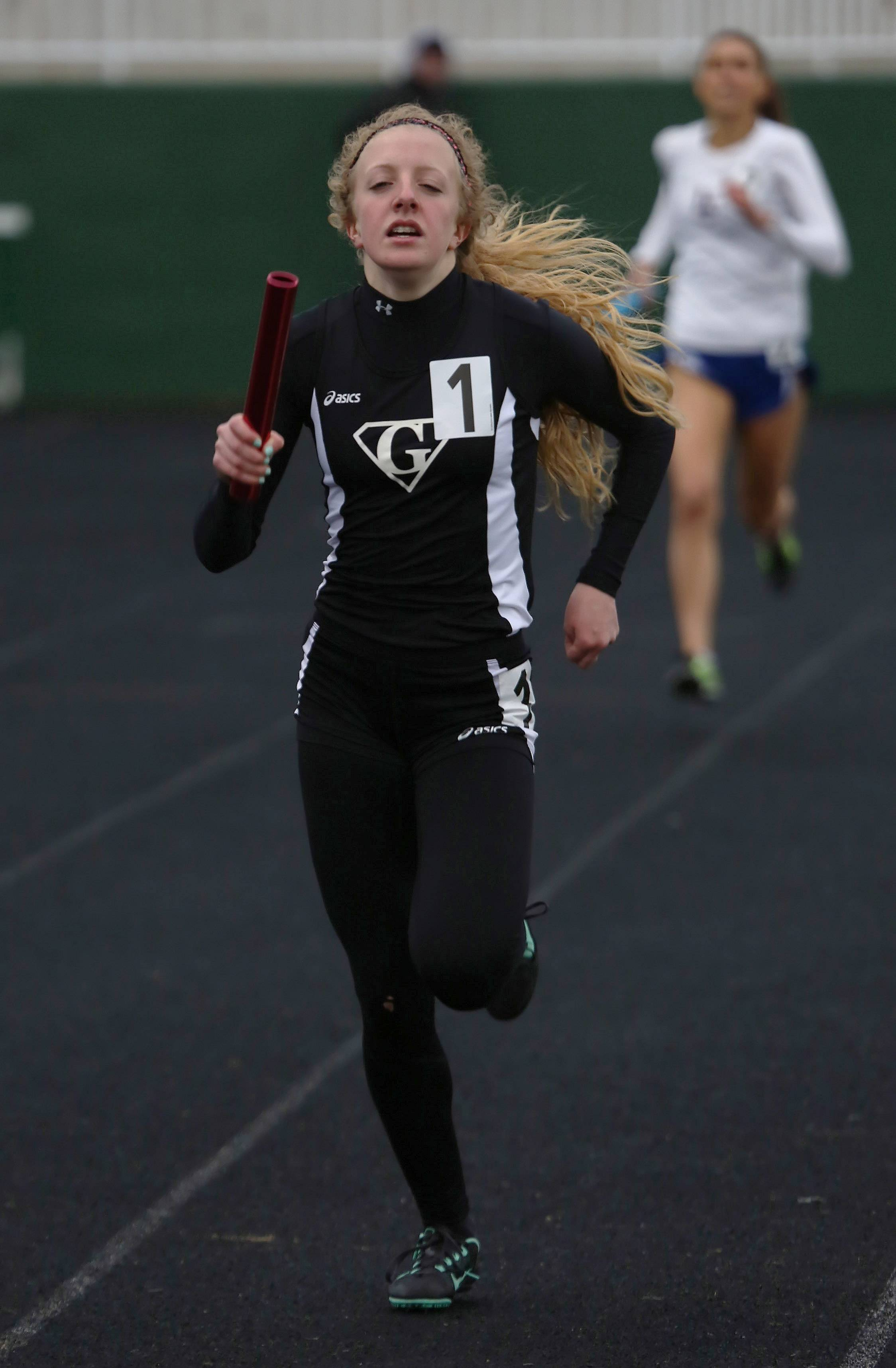 Grant runner Lauren Troemel finishes her final leg of the 4x800-meter relay during the Lake County Invite on Thursday at Grayslake Central.
