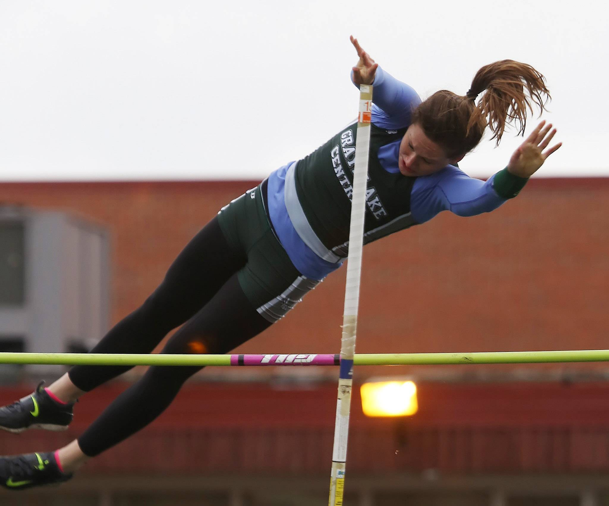 Grayslake Central's Katie Schroeder clears the height in pole vault during the Lake County Invite on Thursday at Grayslake Central.