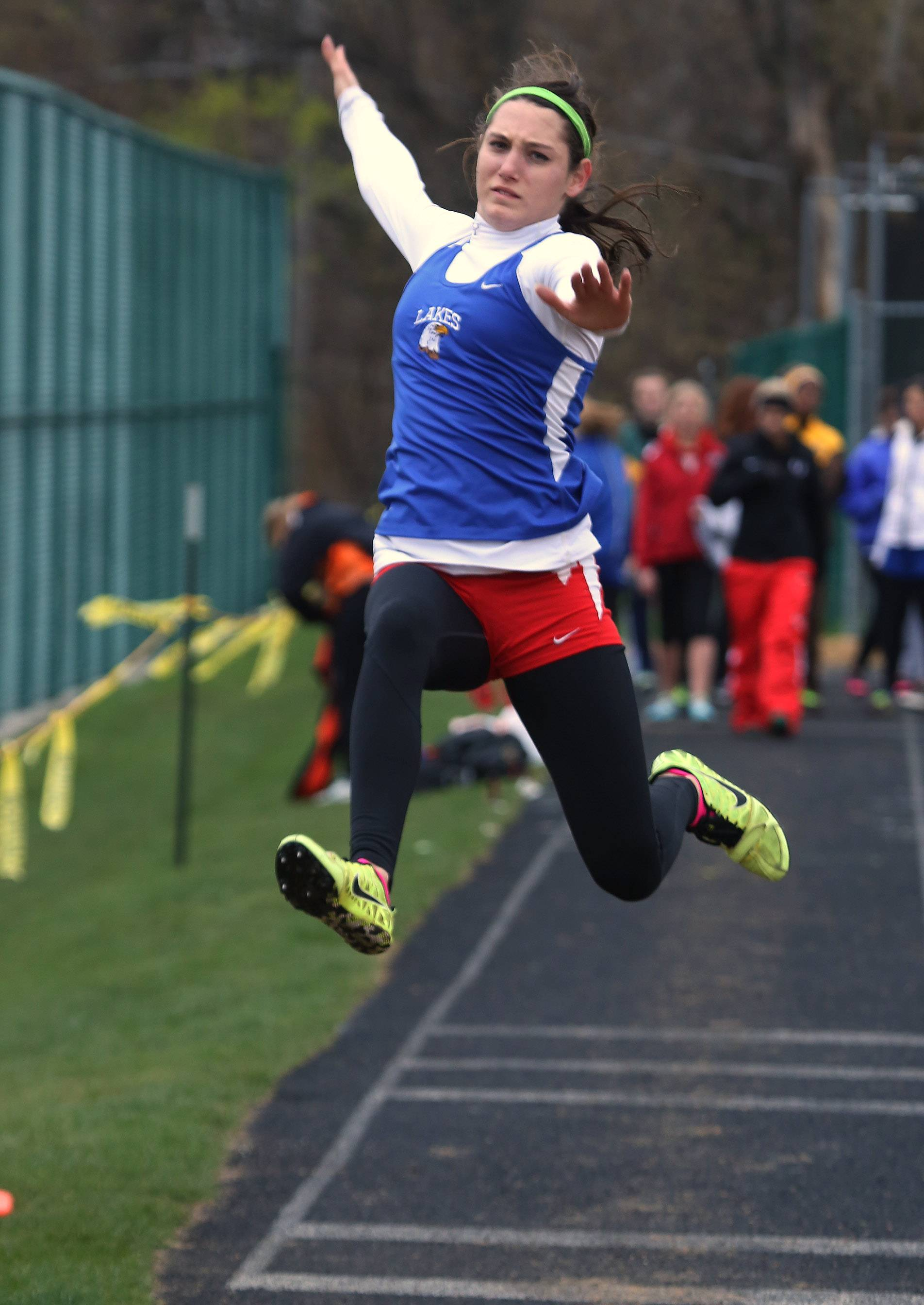 Lakes' Brittani Griesbaum competes in the long jump during the Lake County Invite on Thursday at Grayslake Central.